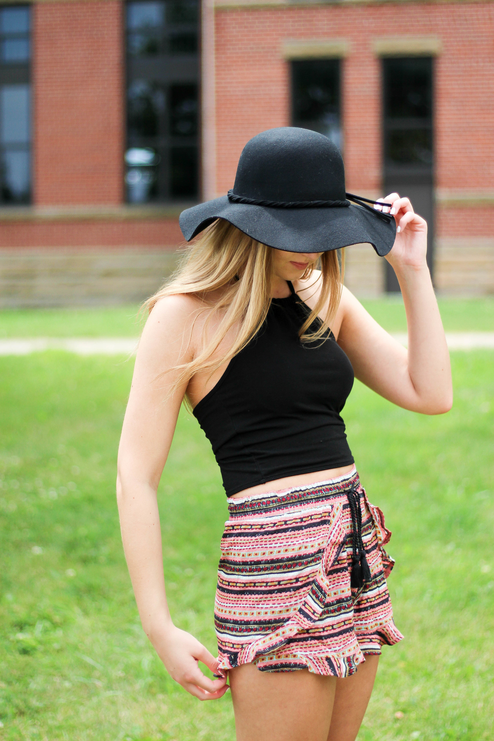 Black hat, floppy hat, brandy Melville top, boho outfit by lauren lindmark on daily dose of charm