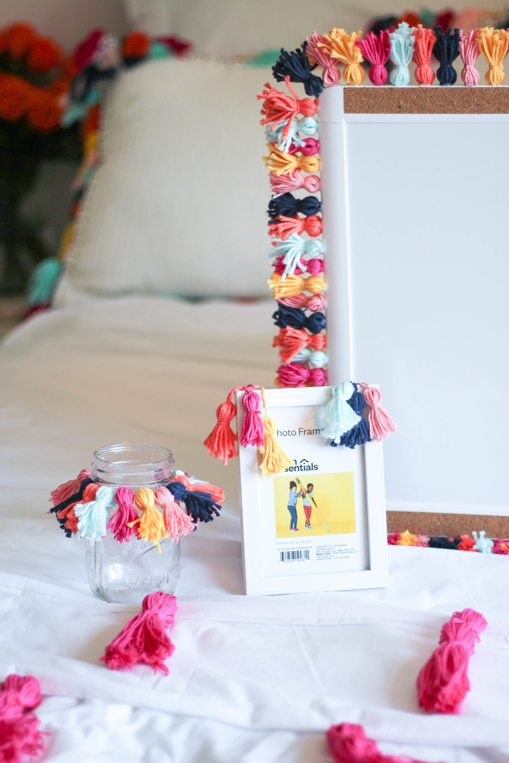 DIY Tassel bedding frame and crafts Tassel decor for dorm room by lauren lindmark on daily dose of charm