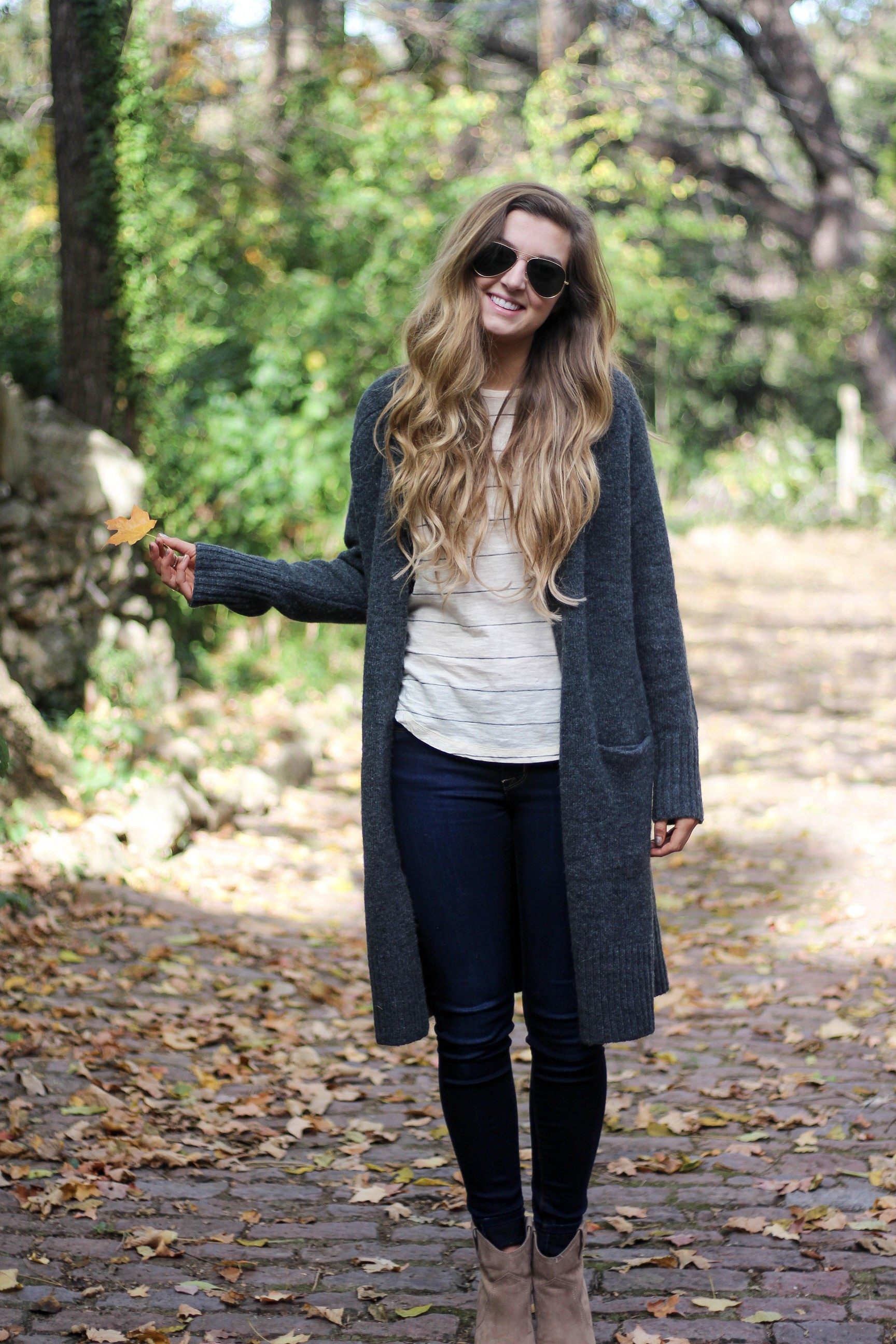Long cardigan with striped shirt cute and simple outfit for fall! Perfectly paired with booties. The perfect fall or winter outfit by Lauren Lindmark on Daily Dose of Charm dailydoseofcharm.com
