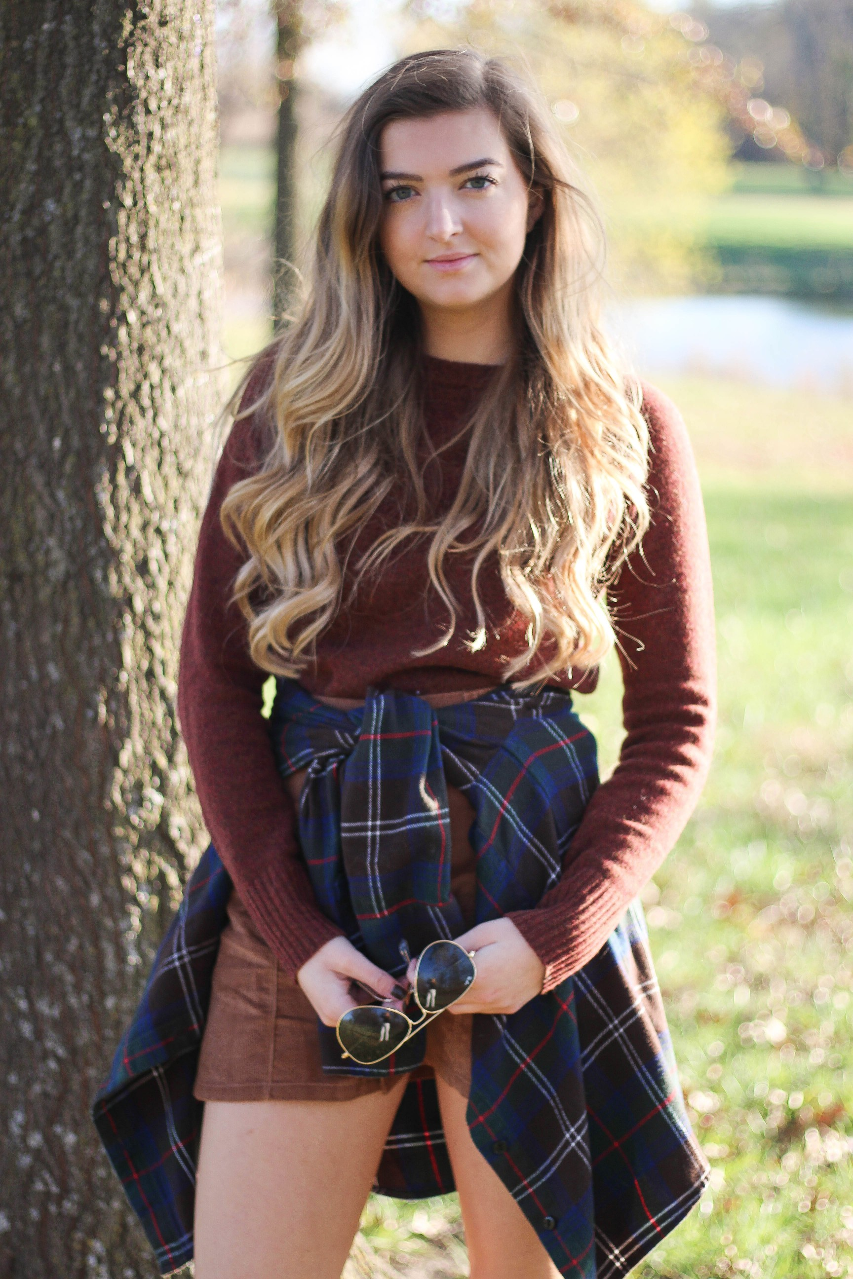 The perfect fall outfit! The corduroy skirt is showing up everywhere so I decided to pair it with a flannel to be a bit different. Of course I added a burgundy sweater because it's my favorite color for fall! As for my boyfriend, he's rocking a JORD wooden watch that I am in love with! Cute couple pictures are my favorite, check out our poses for engagement photo ideas and more! By Lauren Lindmark on Daily Dose of Charm dailydoseofcharm.com