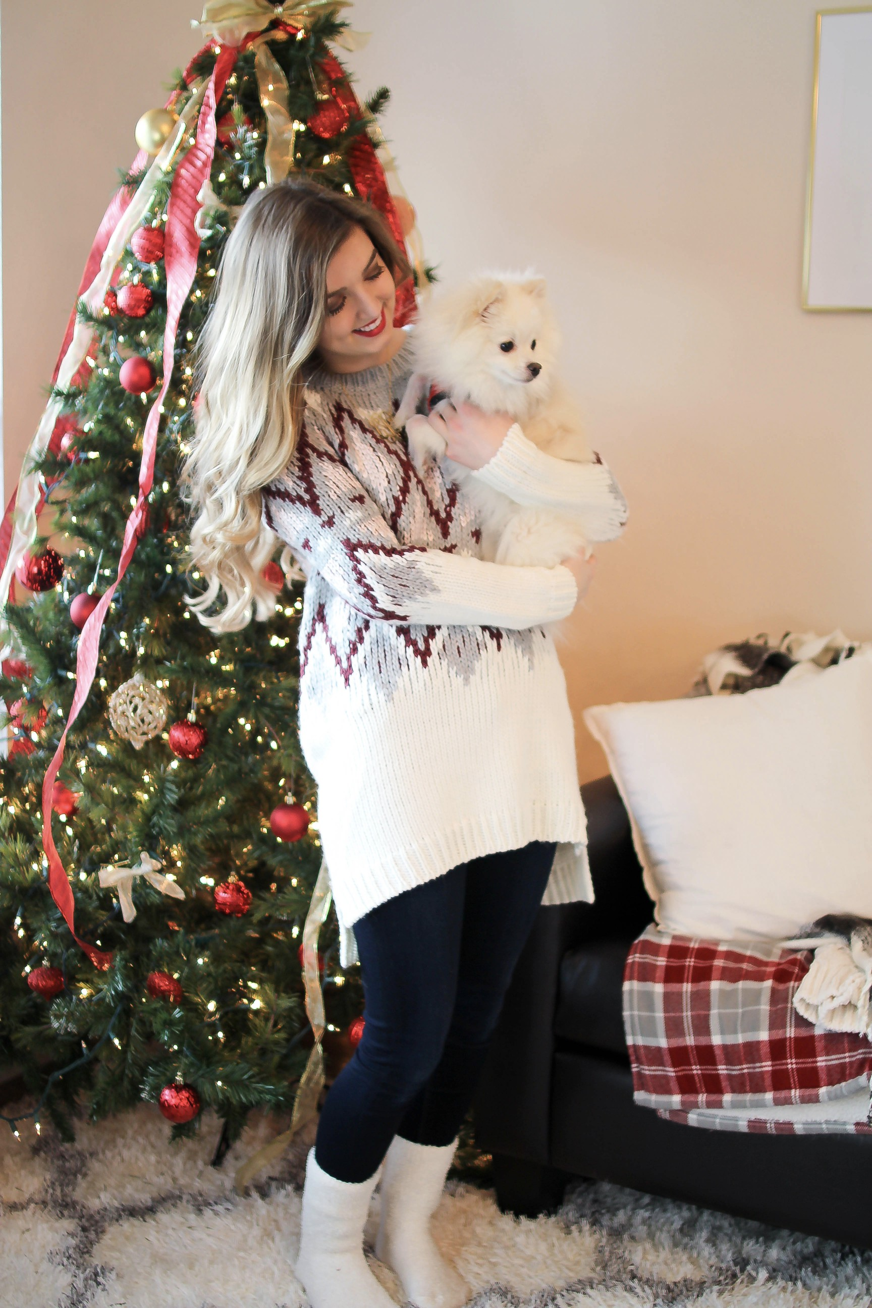 SLEIGH YOUR LOOK! Adorable oversized sweater with fun colors and pattern. Super cozy winter outfit. Pomeranian puppy, white Pomeranian, miniature Pomeranian, toy Pomeranian, red lips and curled hair by Lauren Lindmark dailydoseofcharm.com daily dose of charm