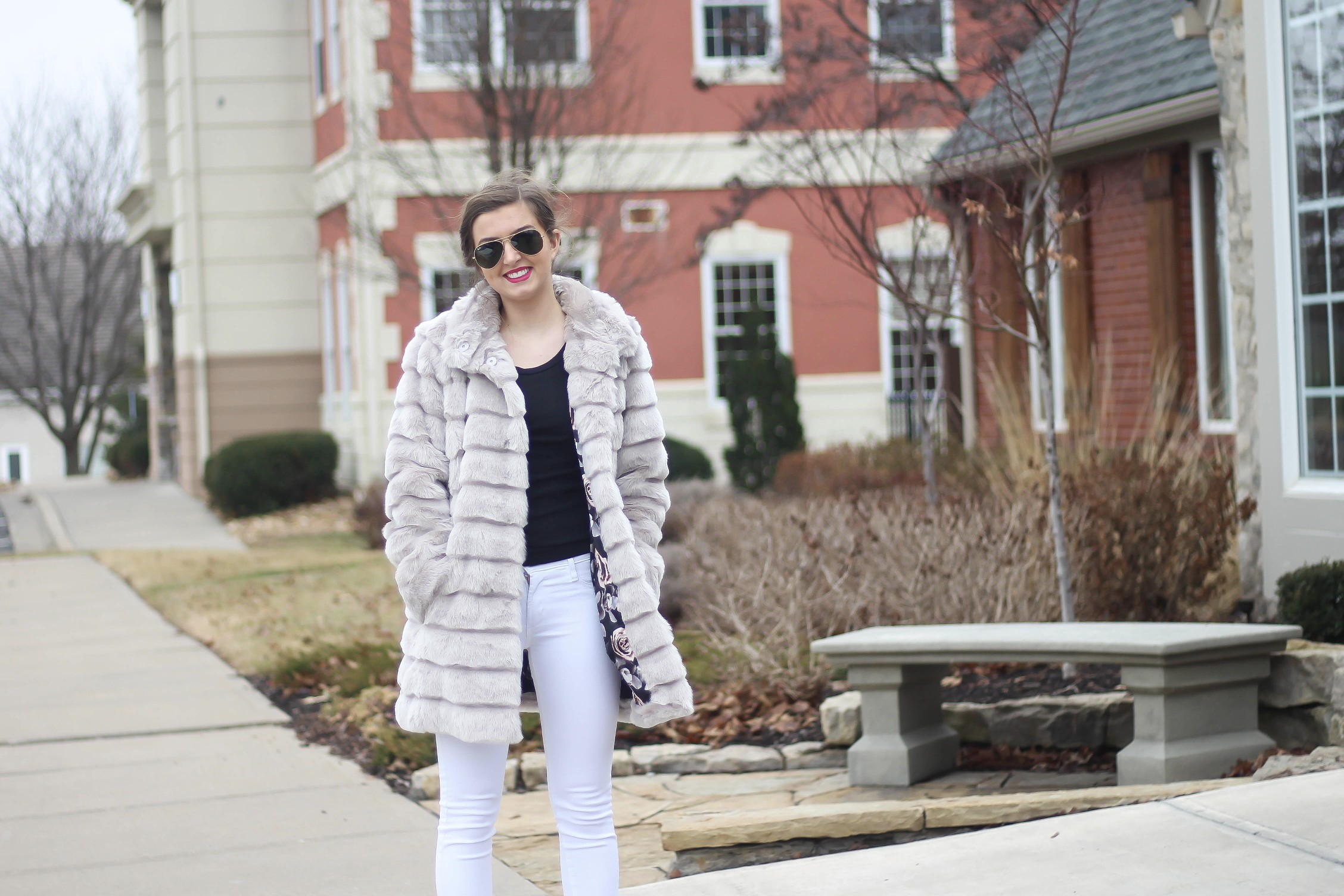 Fur coats are a closet necessity! This faux fur coat is my favorite and look adorable with white pants, cute heels, and bright pink lips! By Lauren Lindmark on dailydoseofcharm.com daily dose of charm