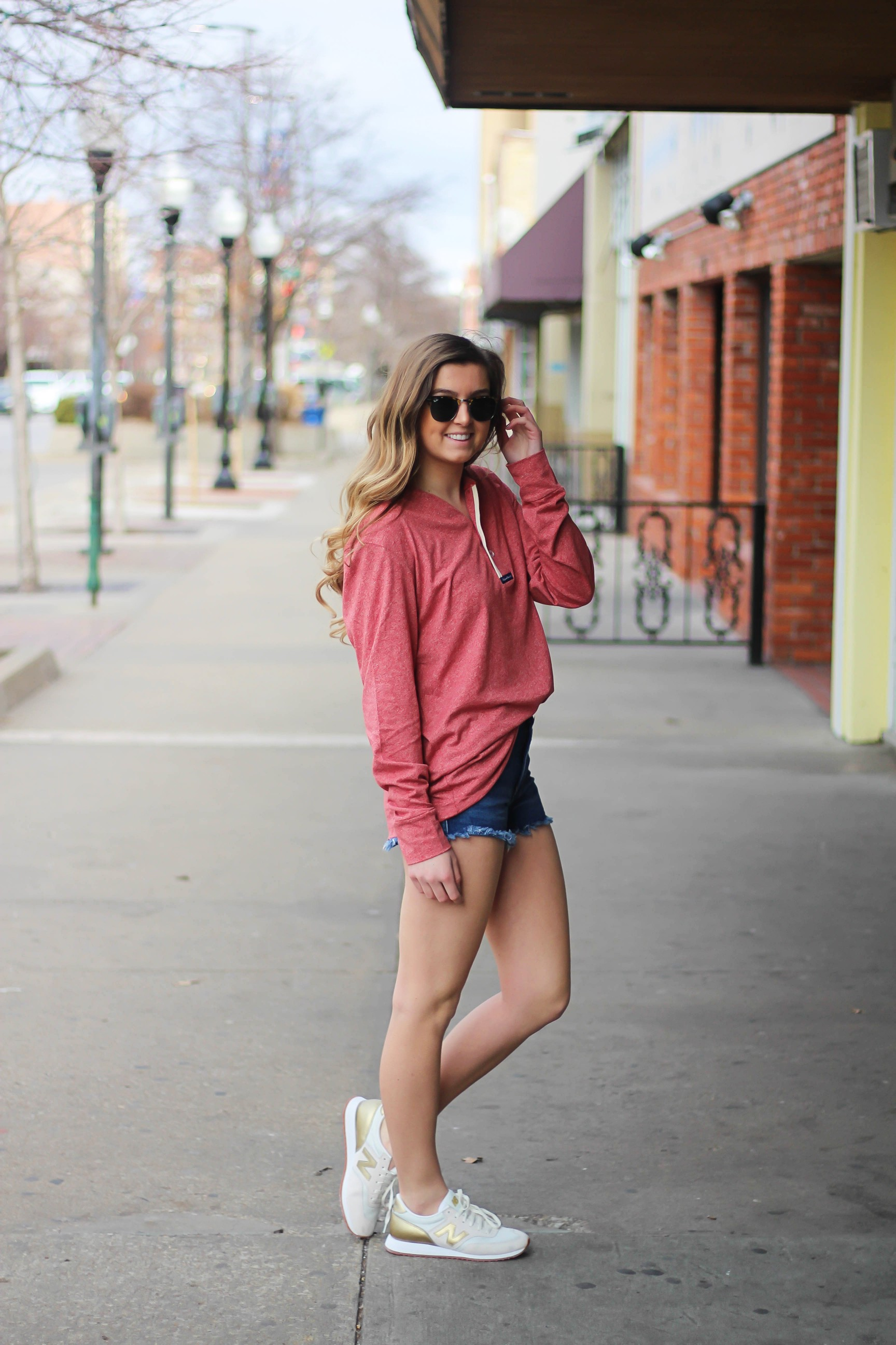 This slouchy boyfriend tee is so comfortable! I love comfy shirts, this one is by Lauren James and comes in so many colors! I paired it with Ray Ban Clubmaster Sunglasses, shorts, and my favorite Gold New Balance sneakers! By Lauren Lindmark and daily dose of charm dailydoseofcharm.com