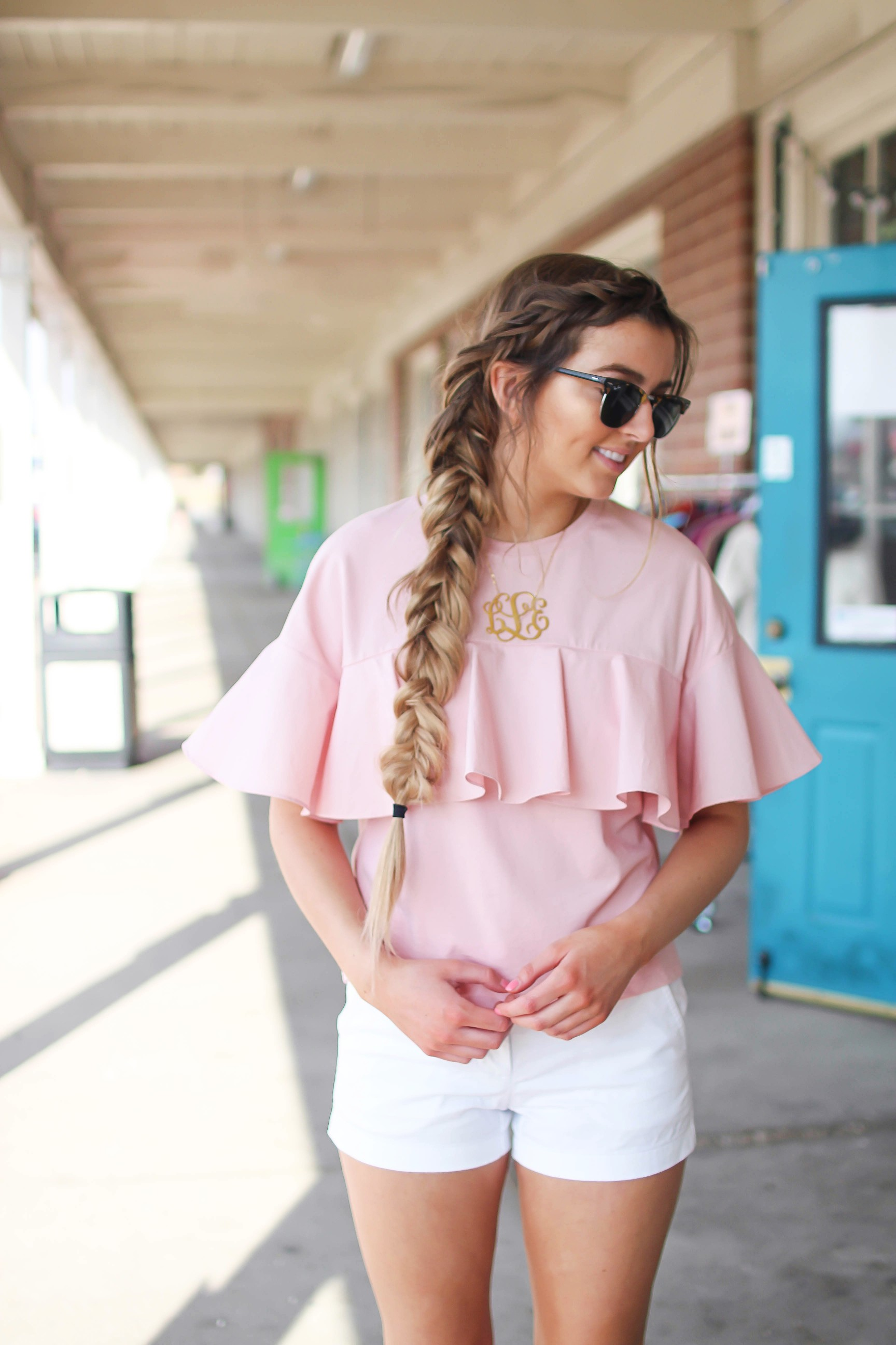 "The cutest ruffle top you will ever find is only $35! I love this pink full shirt, I can't stop wearing it! I paired it with my white j.crew chino shorts and my 2.5"" monogram necklace. I am also wearing my favorite ray ban club master sunglasses. By Lauren Lindmark on dailydoseofcharm.com daily dose of charm"