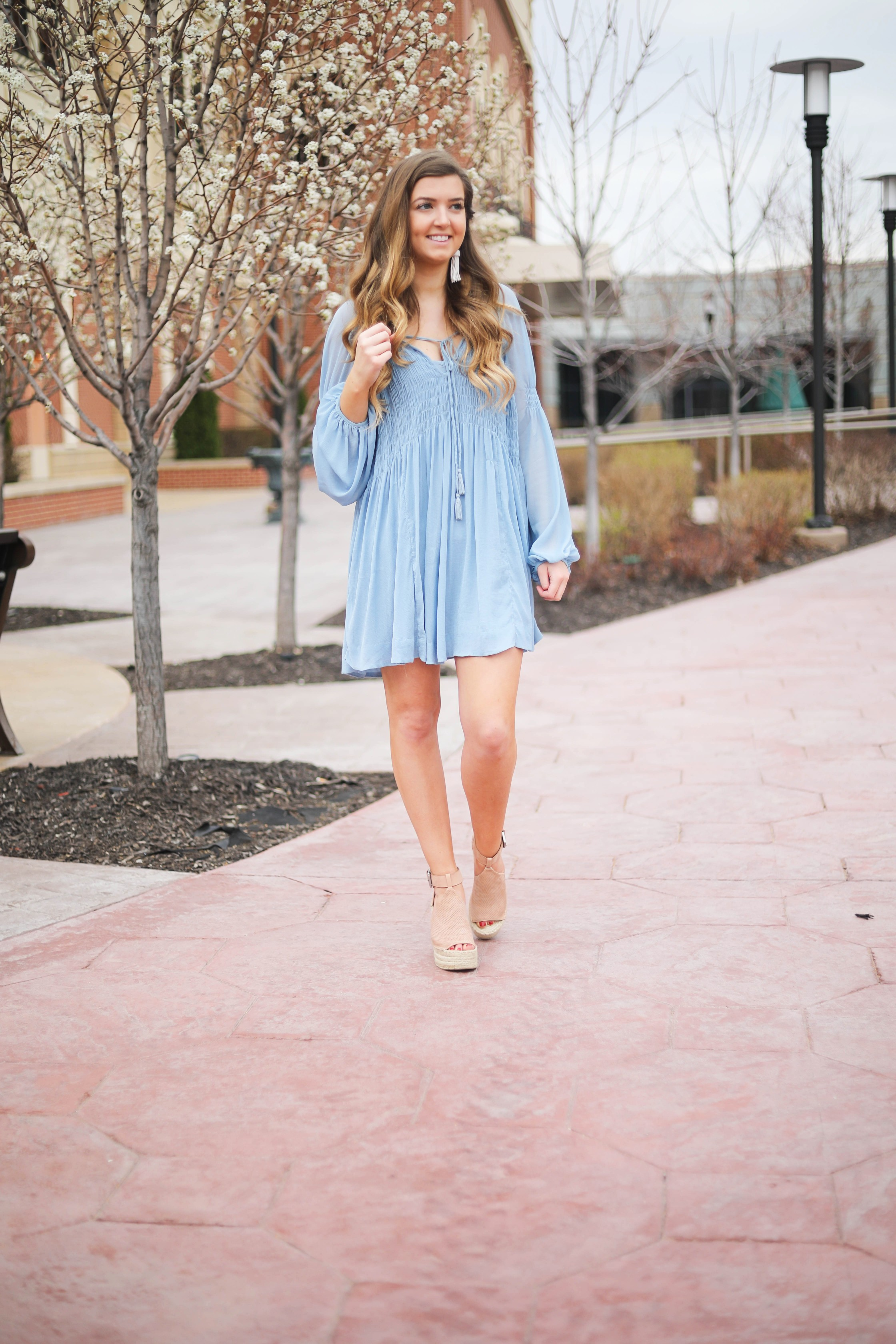 The prettiest flowy light blue dress up on the blog! Paired with Marc Fisher wedges and Lisi Lerch white tassel earrings. Details and links are all on the blog dailydoseofcharm.com daily dose of charm lauren Lindmark