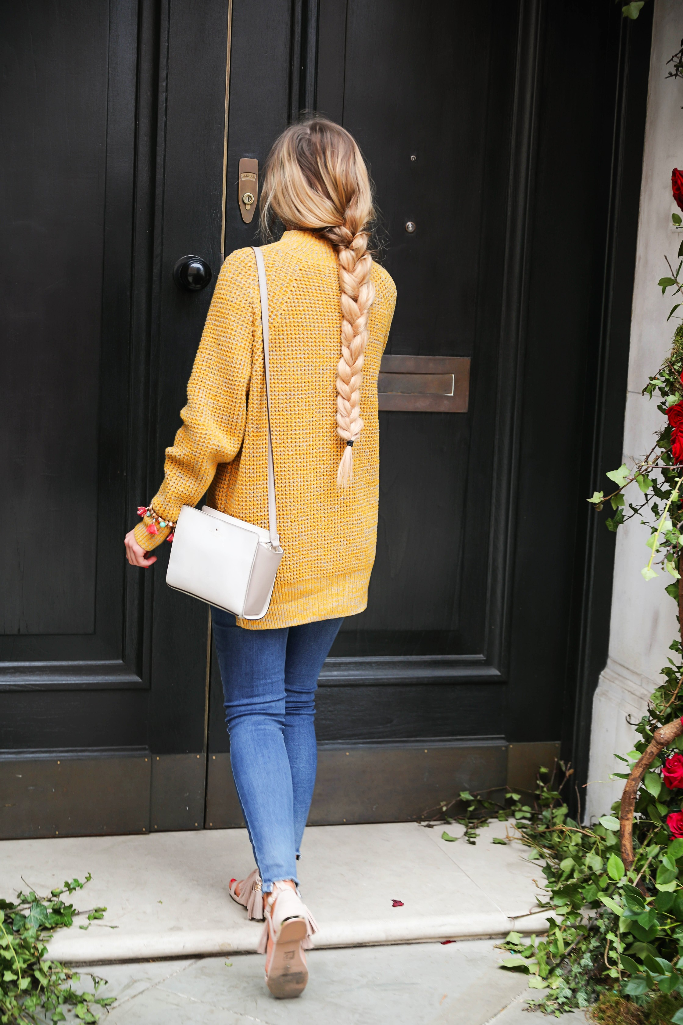 The cutest yellow sweater up on the blog! These photos were taken in front of the most beautiful roses in London! Cute London outfit! By Lauren Lindmark on dailydoseofcharm.com daily dose of charm