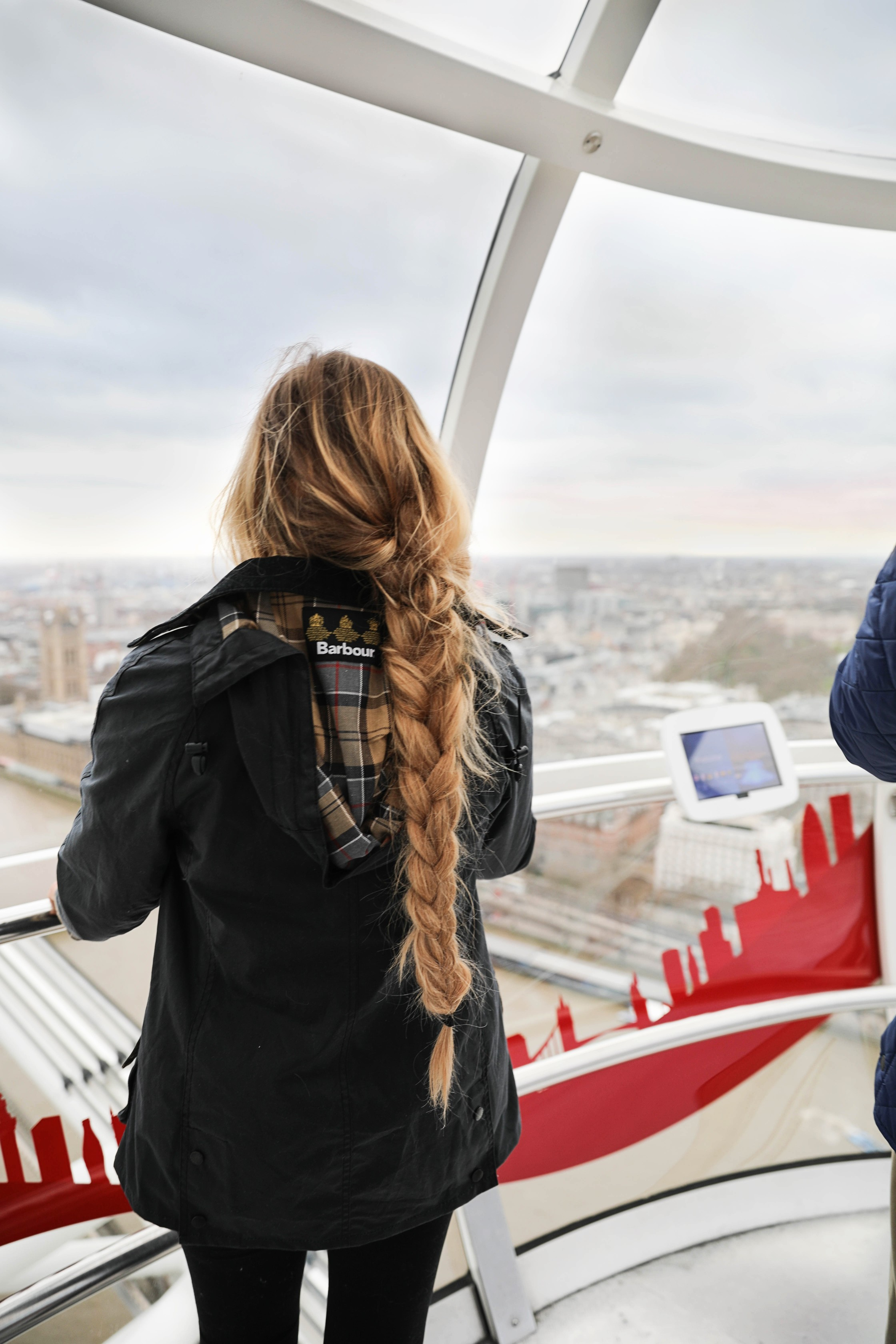 London Adventure post! Photos from the London Eye! Wearing a Barbour coat and England crewneck with my favorite gold sneakers by new balance! By Lauren Lindmark on daily dose of charm dailydoseofcharm.com
