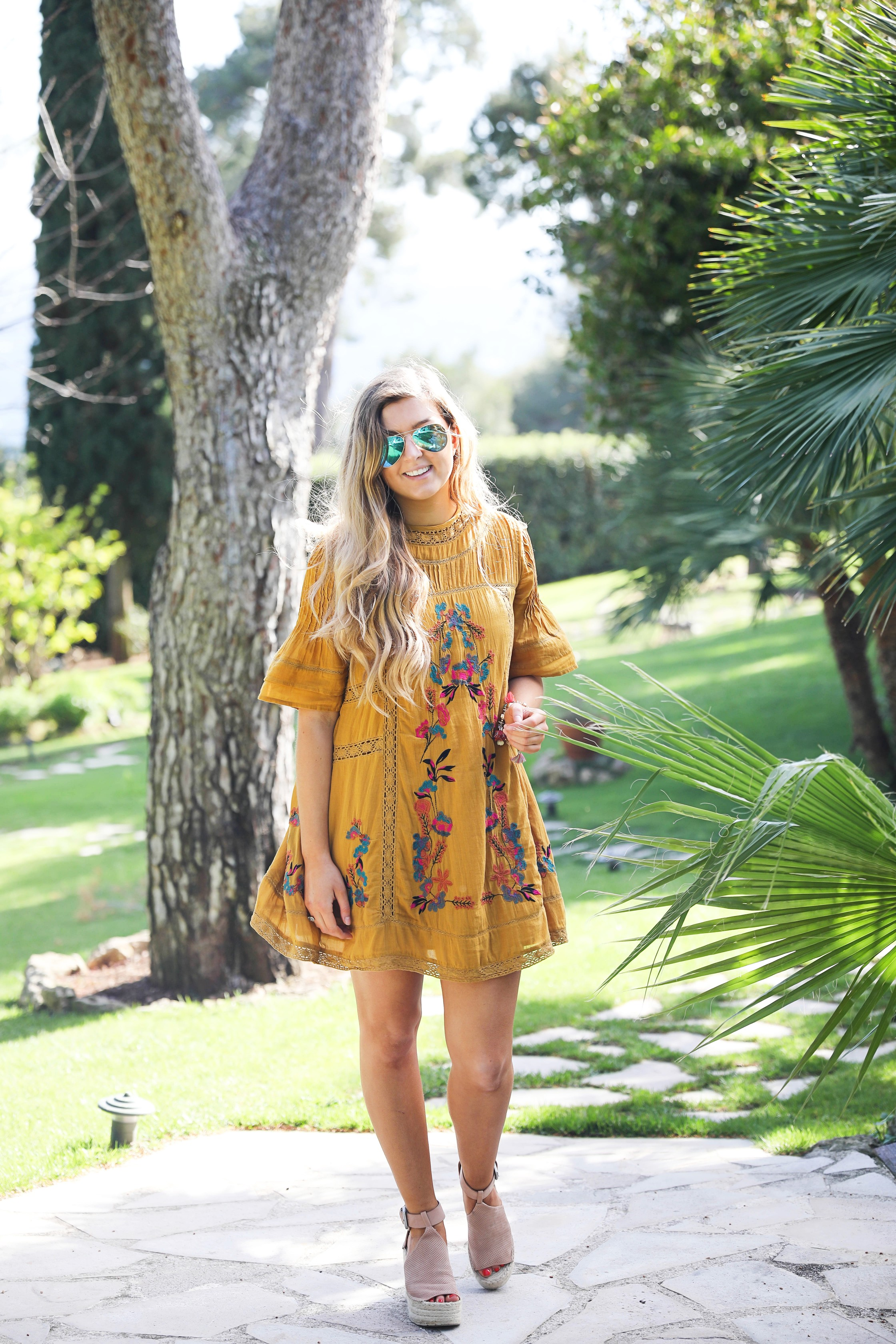 The cutest free people yellow dress! Perfect tropical dress and look so good with my blue mirrored sunglasses! I paired them with my rose Marc Fisher sandals. Full details on the blog dailydoseofcharm.com by lauren Lindmark daily dose of charm
