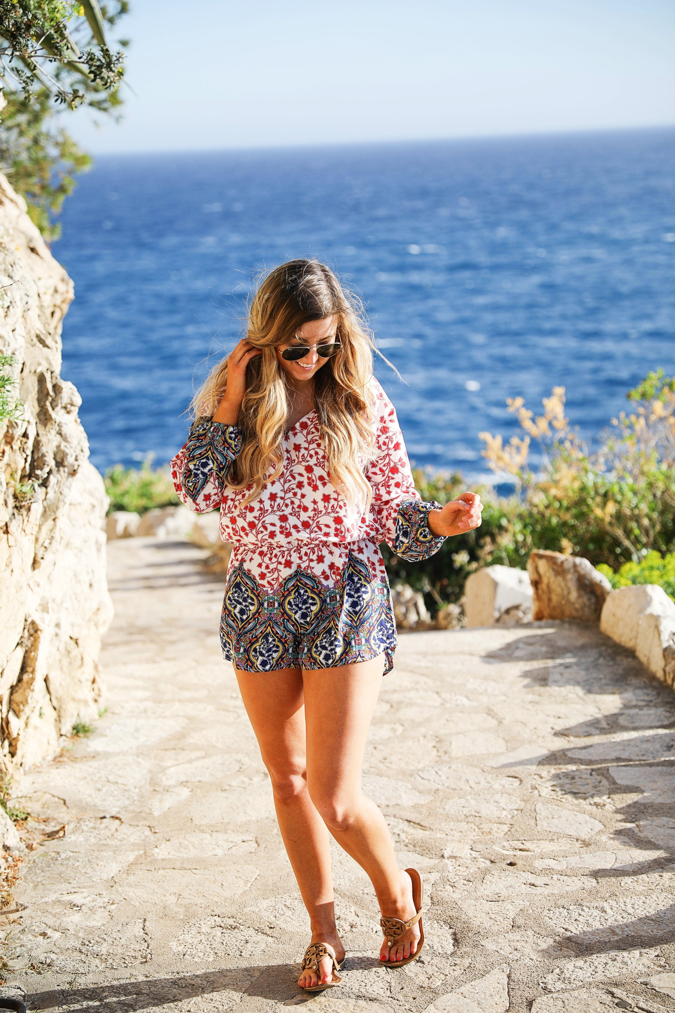 Romper by the ocean in Nice, France. The perfect outfit for a beach day! By Lauren Lindmark on dailydoseofcharm.com daily dose of charm fashion blog