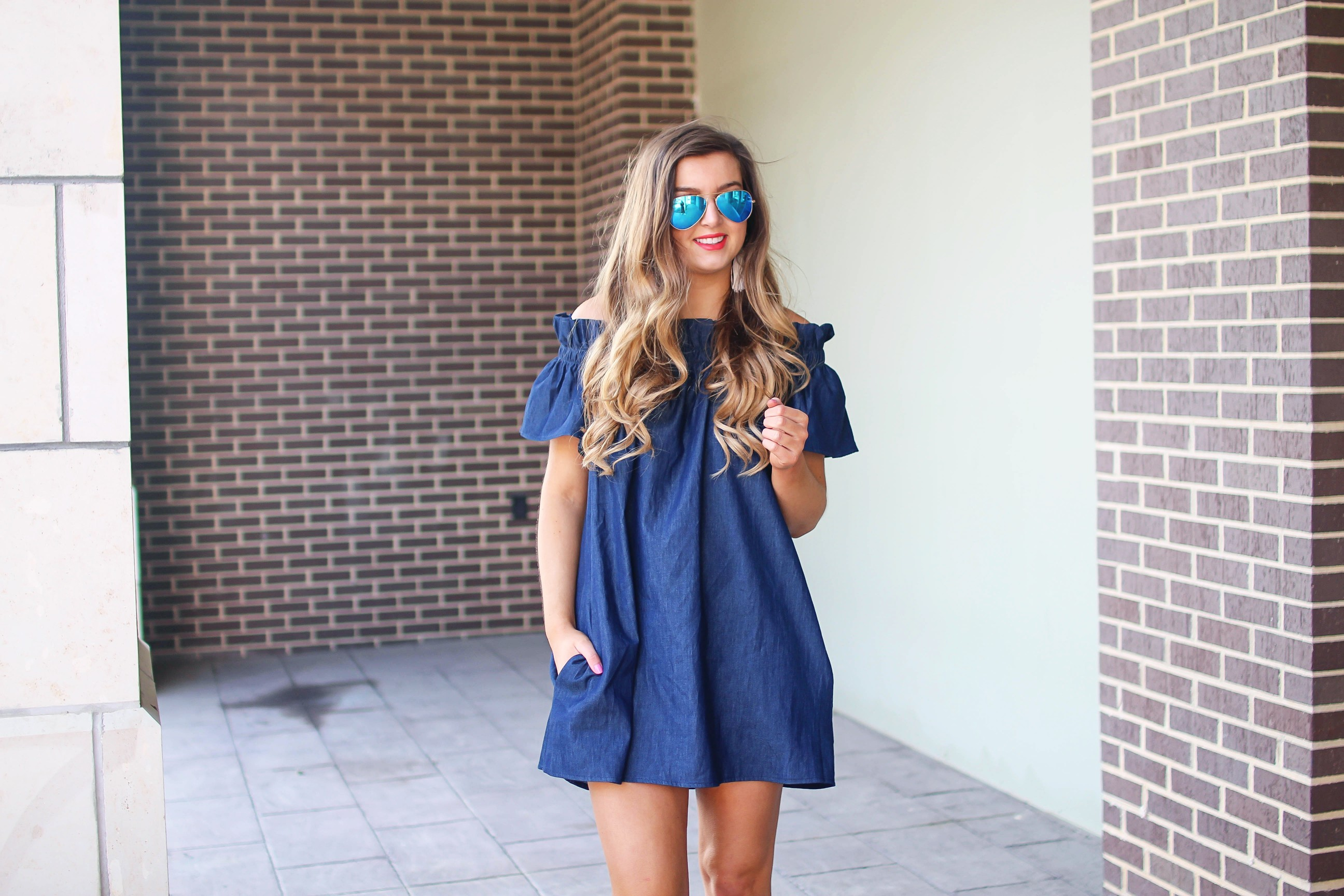Denim off the shoulder dress! I love the denim trend for spring and this dress is a perfect addition to your closet! I paired it with brown wedges and Lisi Lerch tassel earrings. Also my blue ray ban aviators that are on sale! By Lauren Lindmark on dailydoseofcharm.com daily dose of charm