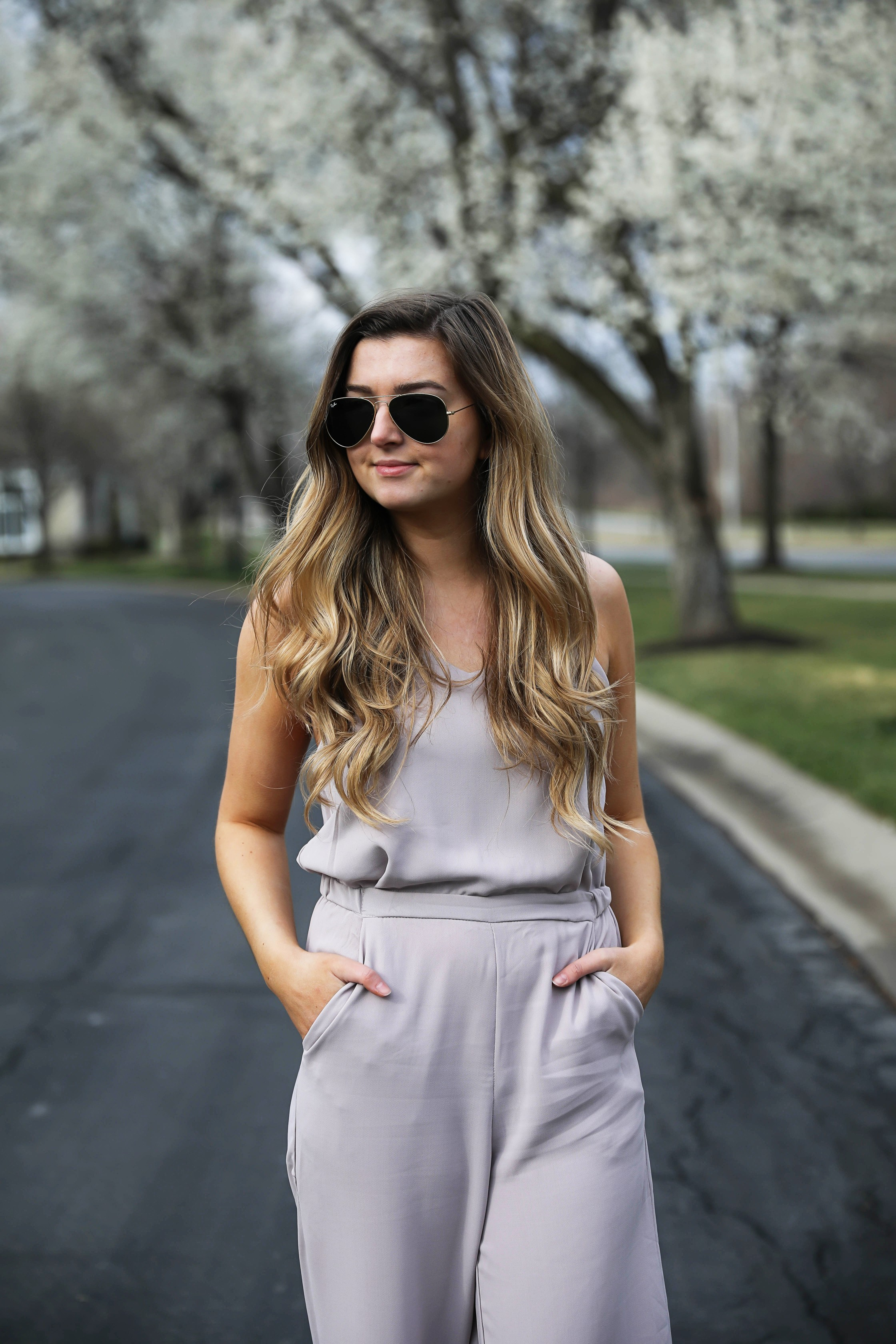 Light Pink Flowy Jumpsuit! Paired with the cutest tied flats and ray ban aviators! By Lauren Lindmark on Daily Dose of Charm dailydoseofcharm.com