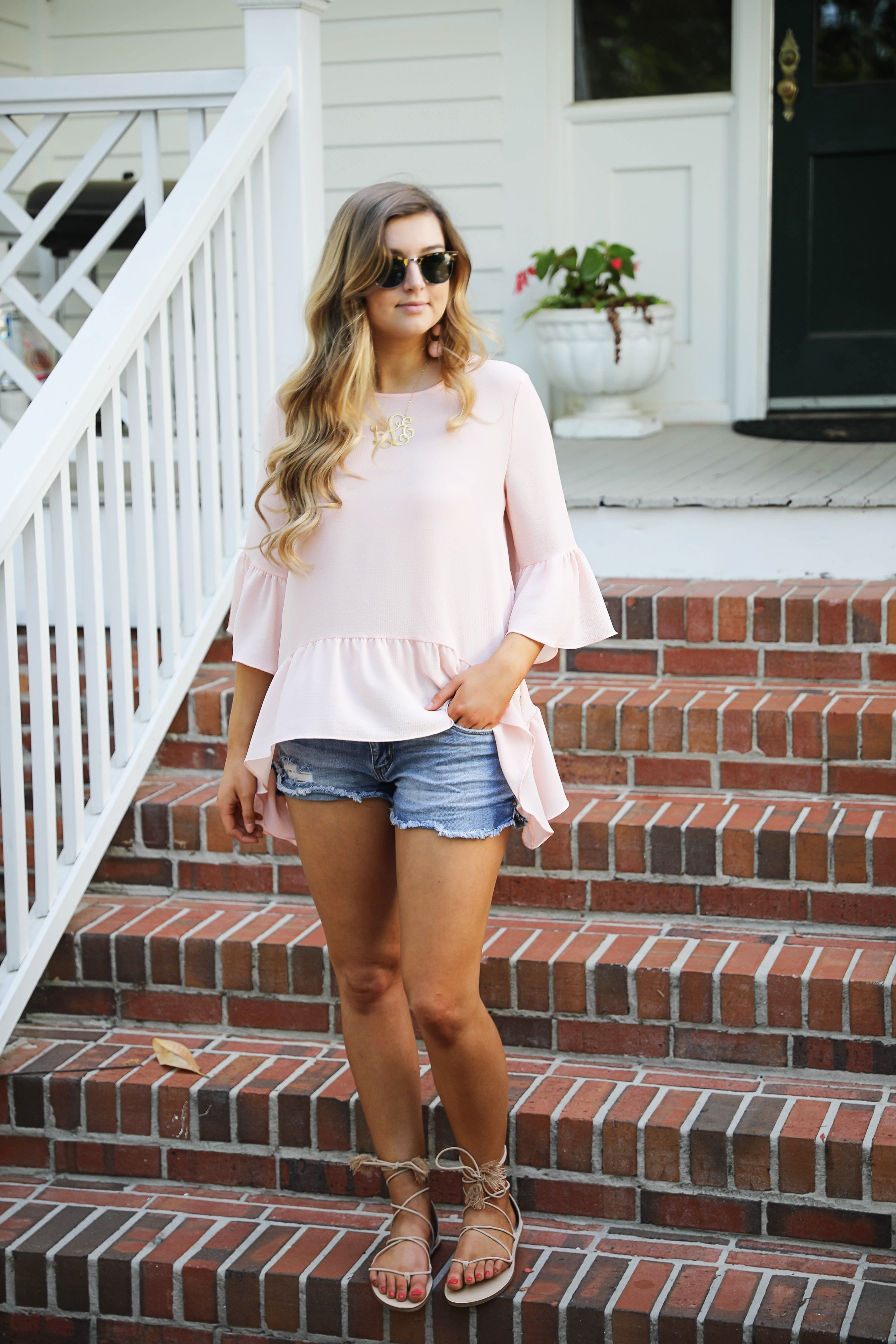 Flowy pink peplum top perfect for a southern outfit! Georgia porch outfit from Nordstrom. By fashion blogger Lauren Lindmark on dailydoseofcharm.com daily dose of charm