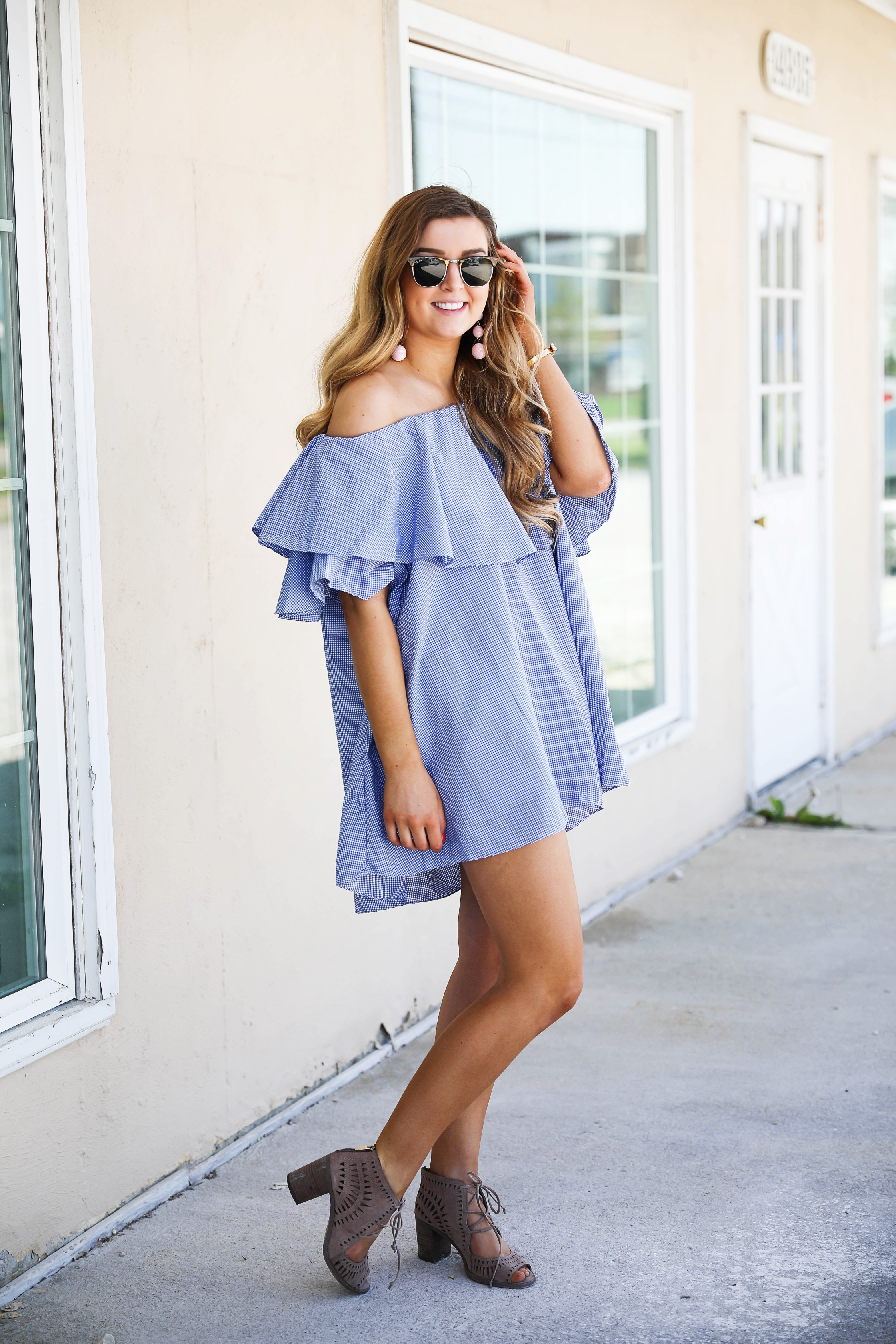 Off the shoulder gingham ruffle dress perfect for spring outfit ideas or summer dresses. by Lauren Lindmark on dailydoseofcharm.com daily dose of charm