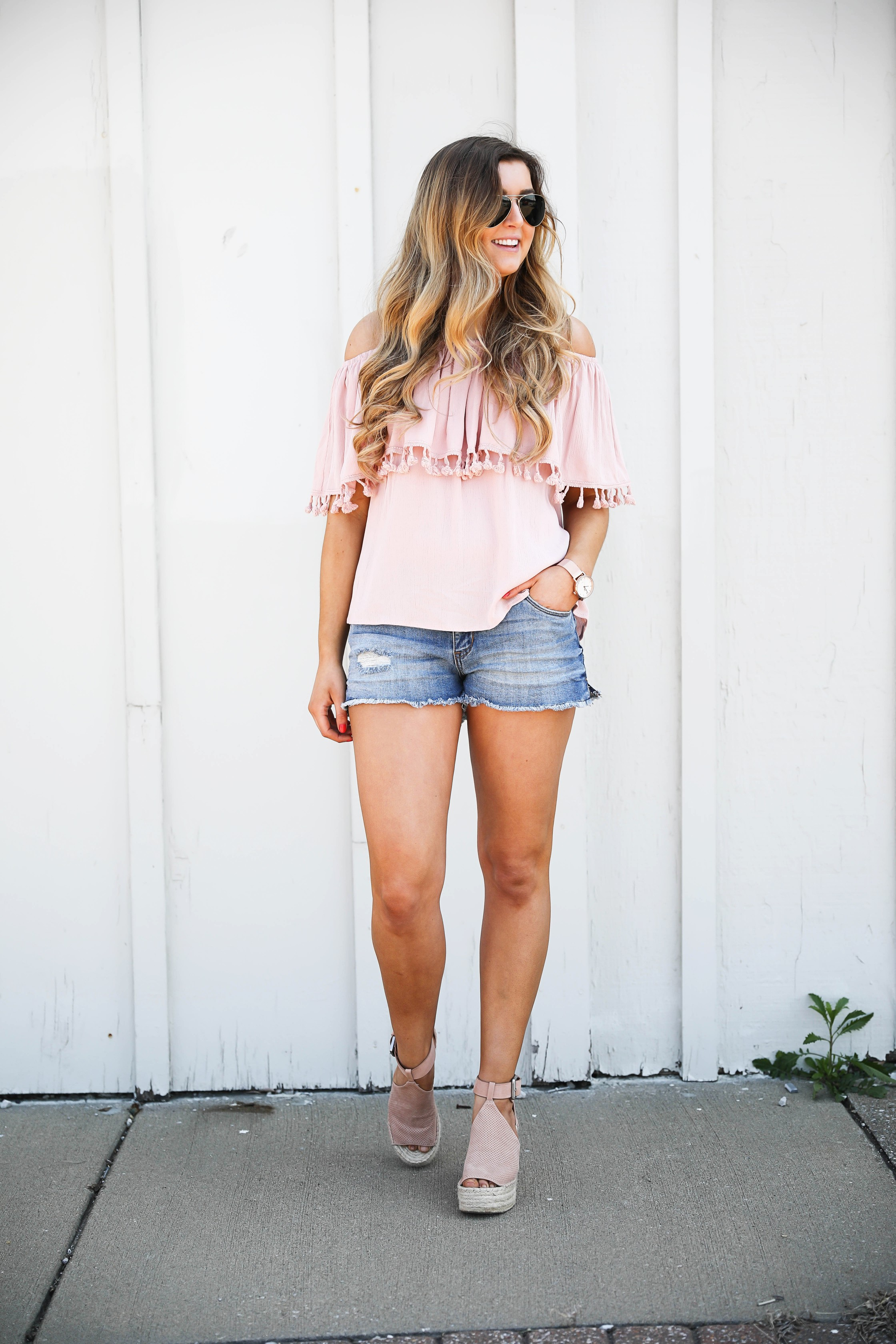 Pink ruffle pom pom top with jean shorts. This is the cutest spring outfit ever! I love the ruffle trend! on Daily Dose of Charm by Lauren Lindmark dailydoseofcharm.com