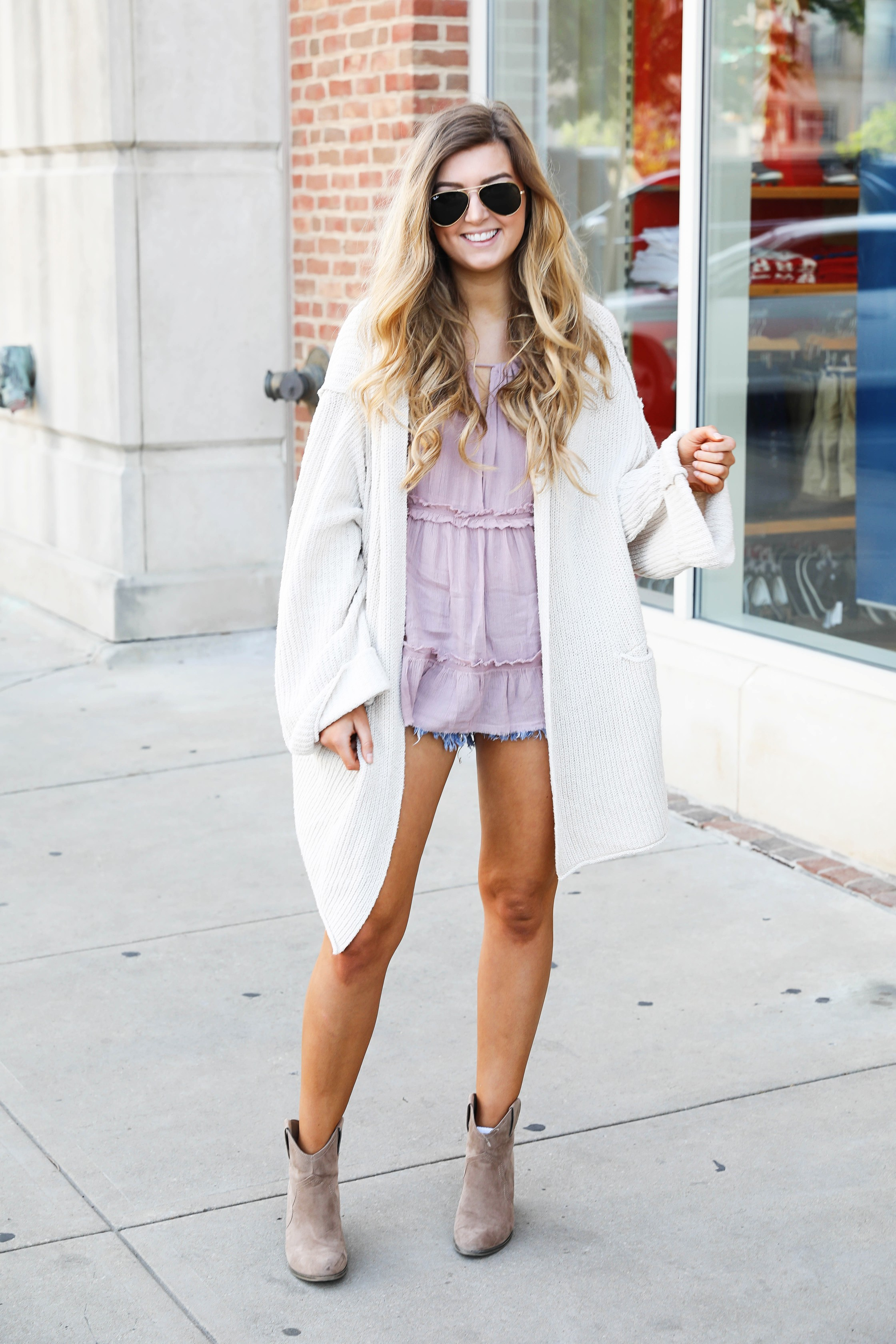 The perfect spring outfit! A purple flowy top paired with a slouchy Free People cardigan on Daily Dose of Charm by Lauren Lindmark dailydoseofcharm.com