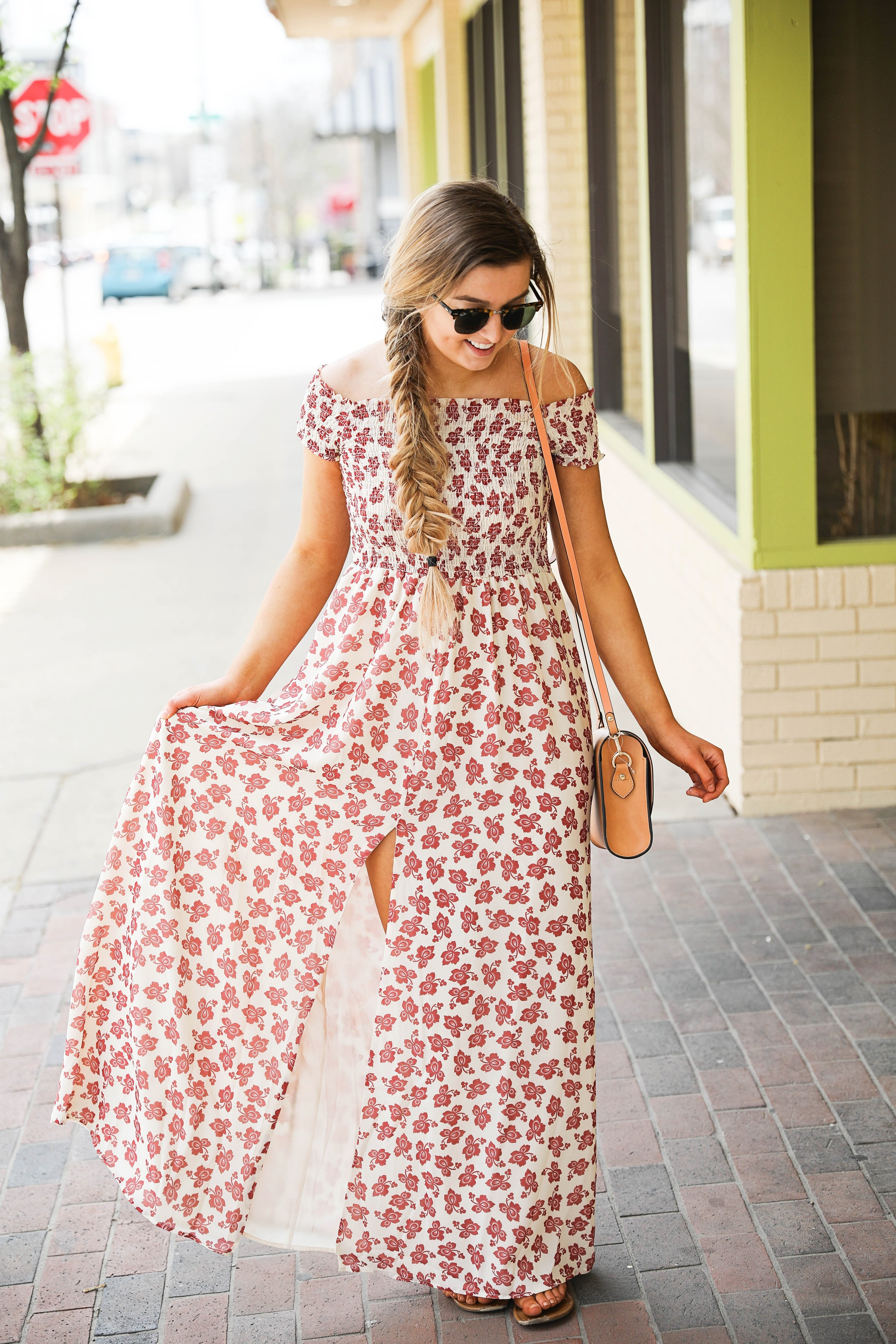 The prettiest floral off the shoulder dress for spring and summer! I am a sucker for a cute floral dress. I love the slit on the front of this dress and I paired it with a brown leather bag and sunglasses! By Lauren Lindmark on daily dose of charm dailydoseofcharm.com