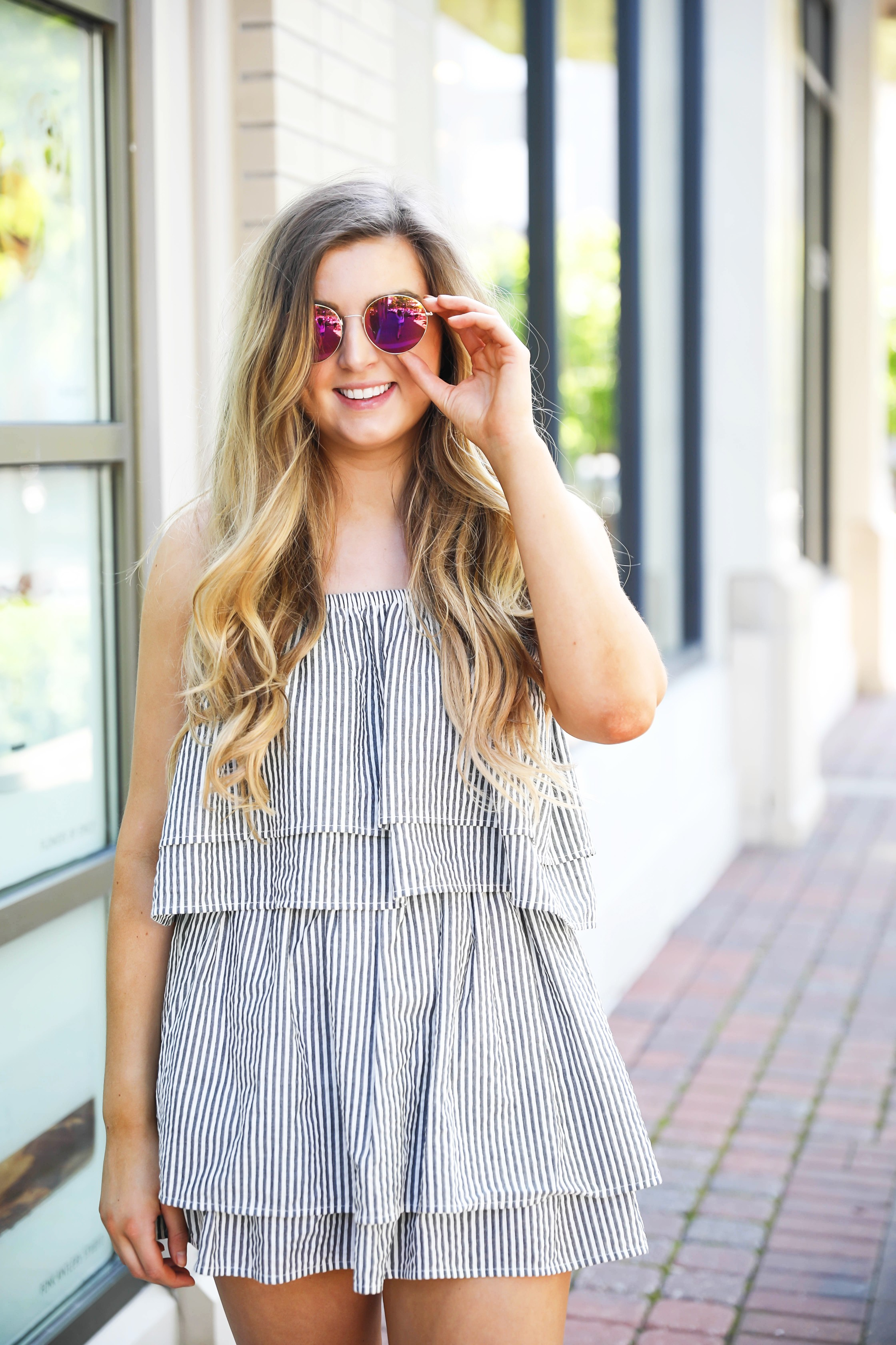 Striped ruffle dress with circle sunglasses and brown leather sandals! By Lauren Lindmark on dailydoseofcharm.com fashion blog daily dose of charm