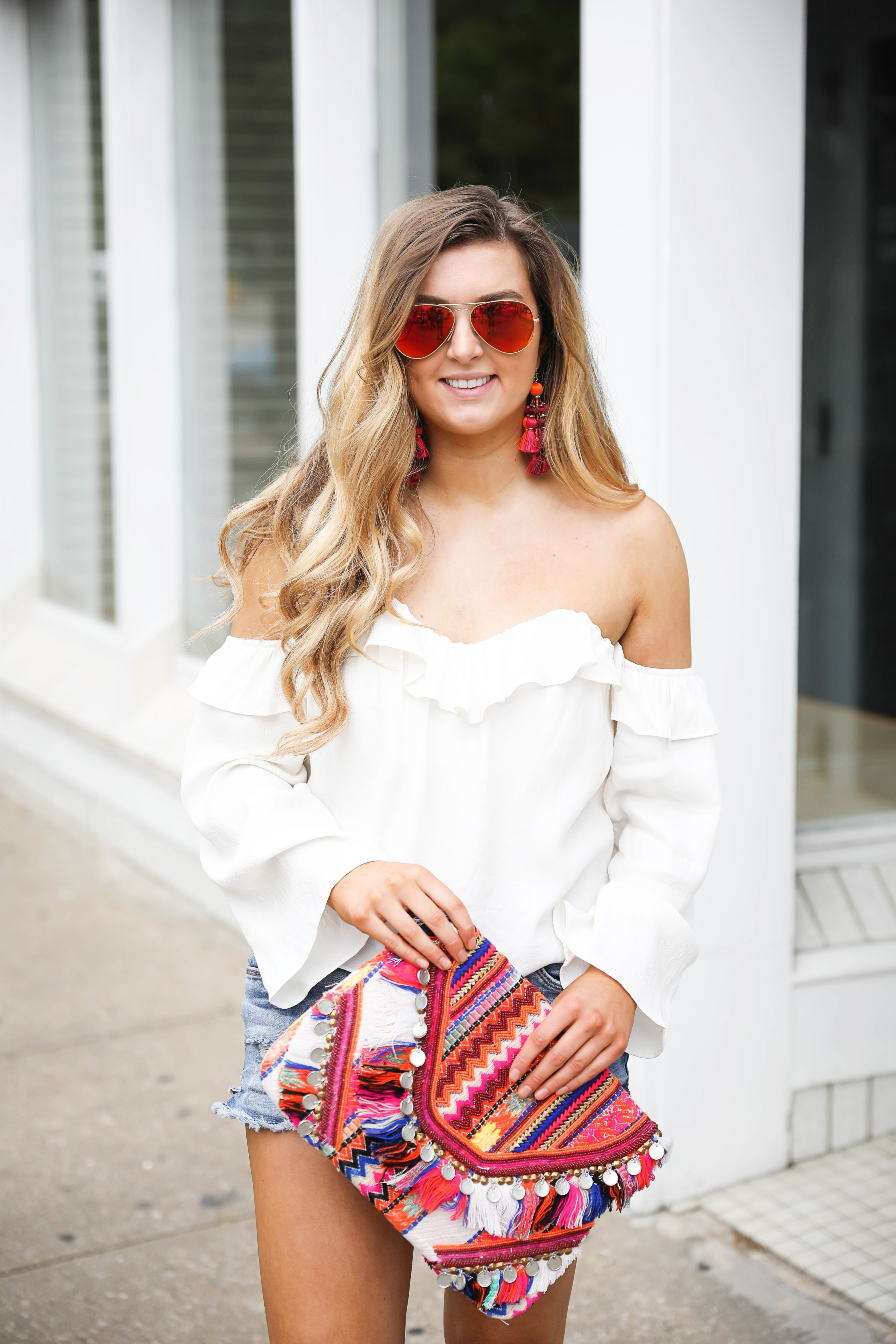 Resort wear chic with off the shoulder white top and fun clutch and earrings on fashion blog daily dose of charm by Lauren Lindmark dailydoseofcharm.com