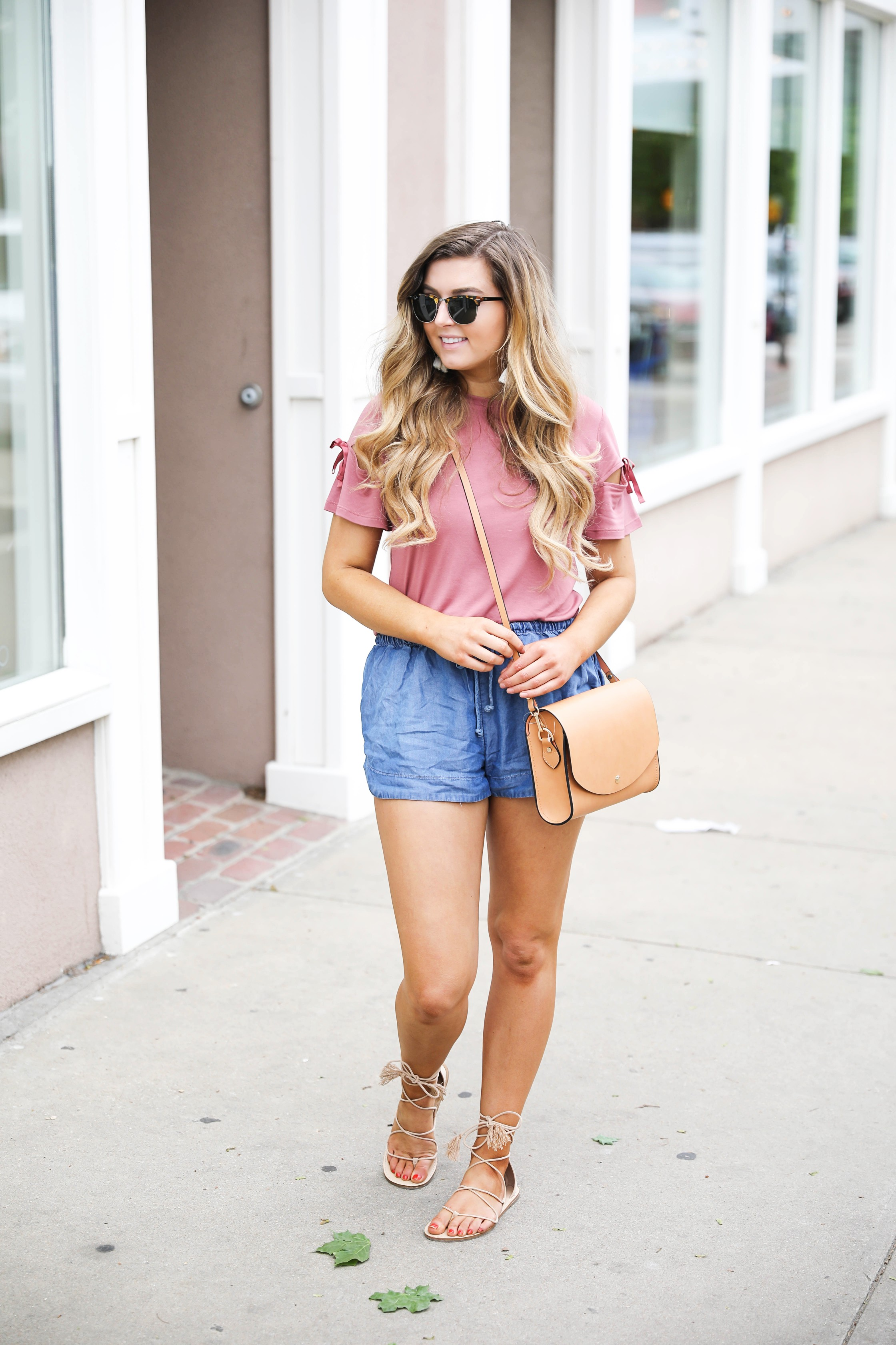 Slouchy pants and tee casual outfit with white tassel earrings and brown cross body by fashion blogger Lauren Lindmark on fashion blog daily dose of charm