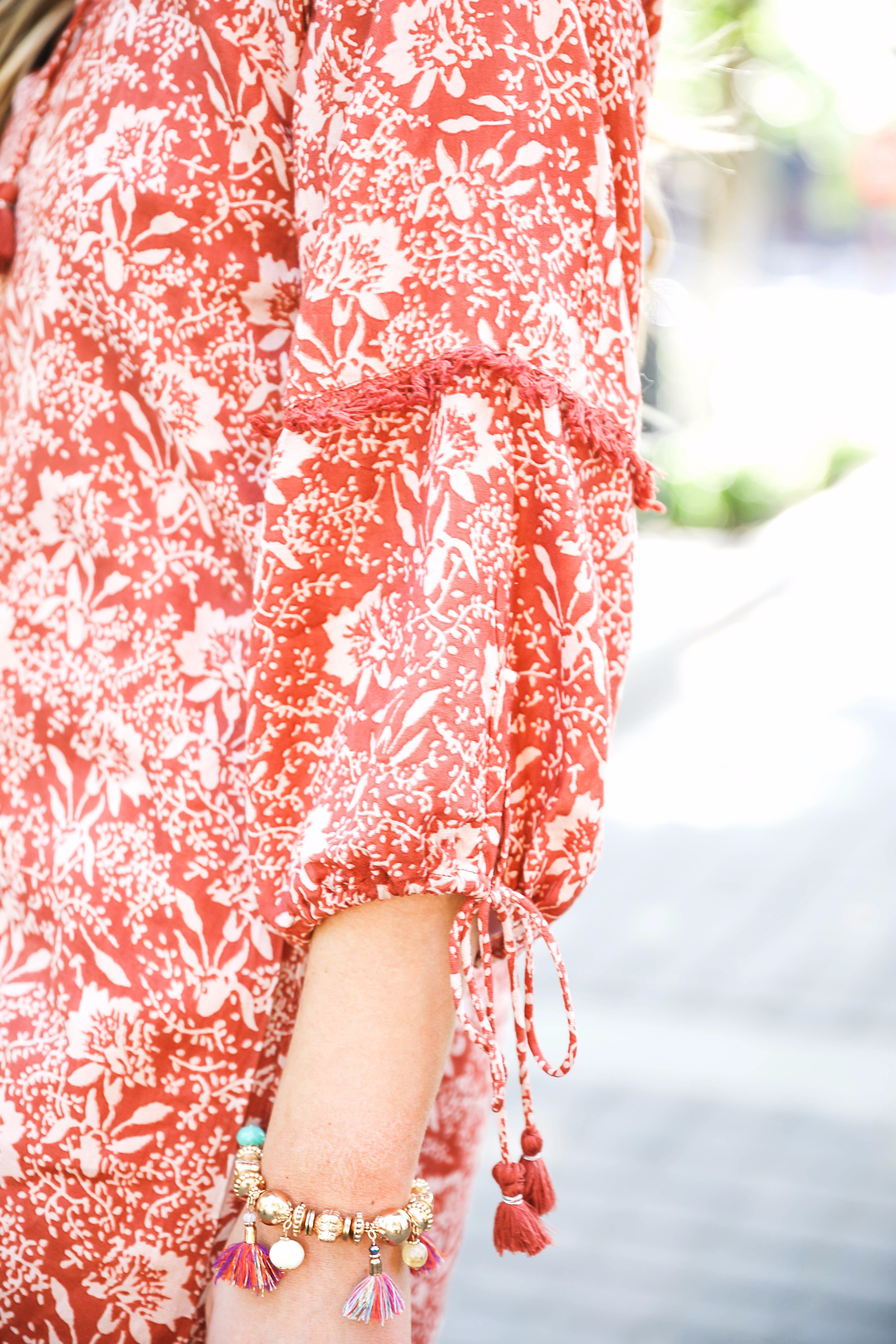 Tassel and ruffle puffy sleeve coral dress with brown Marc fisher wedges by Lauren Lindmark on daily dose of charm fashion blog dailydoseofcharm.com