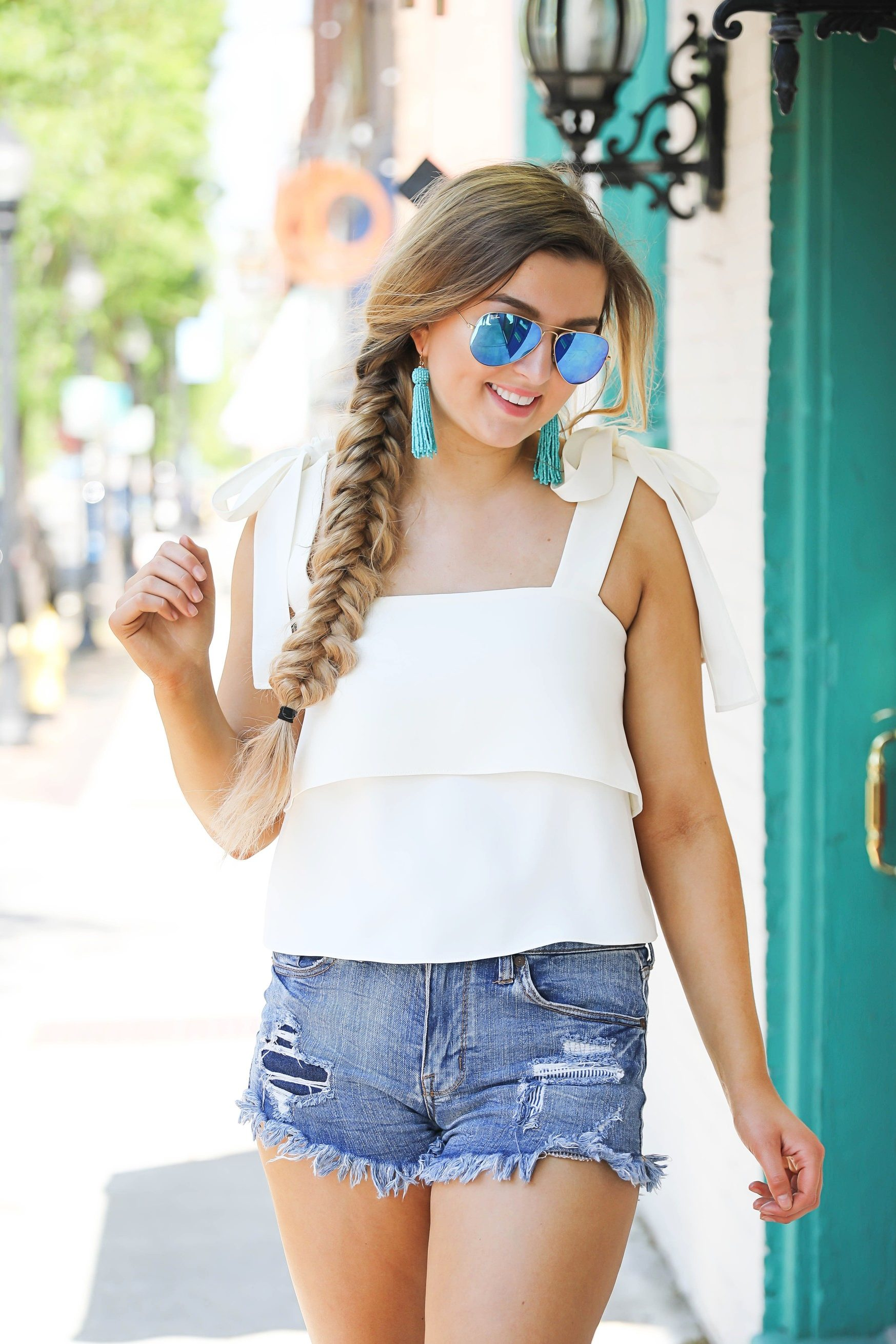 White bow sleeve tank with turquoise tassel earrings and sunglasses on fashion blog daily dose of charm dailydoseofcharm.com lauren lindmark