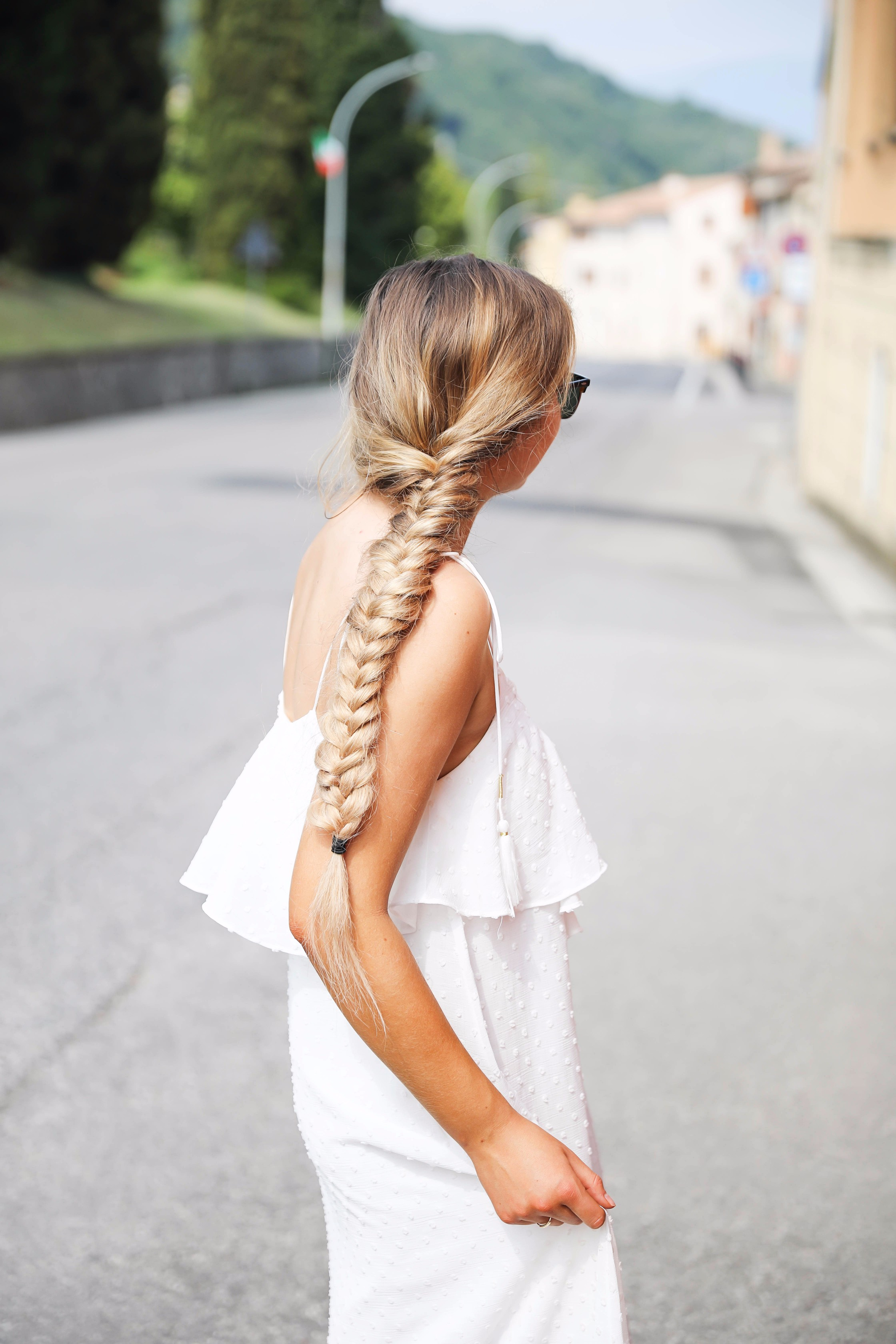 White flowy maxi dress with long fishtail braid in Paderno del Grappa, Italy by fashion blogger Lauren Lindmark daily dose of charm dailydoseofcharm.com