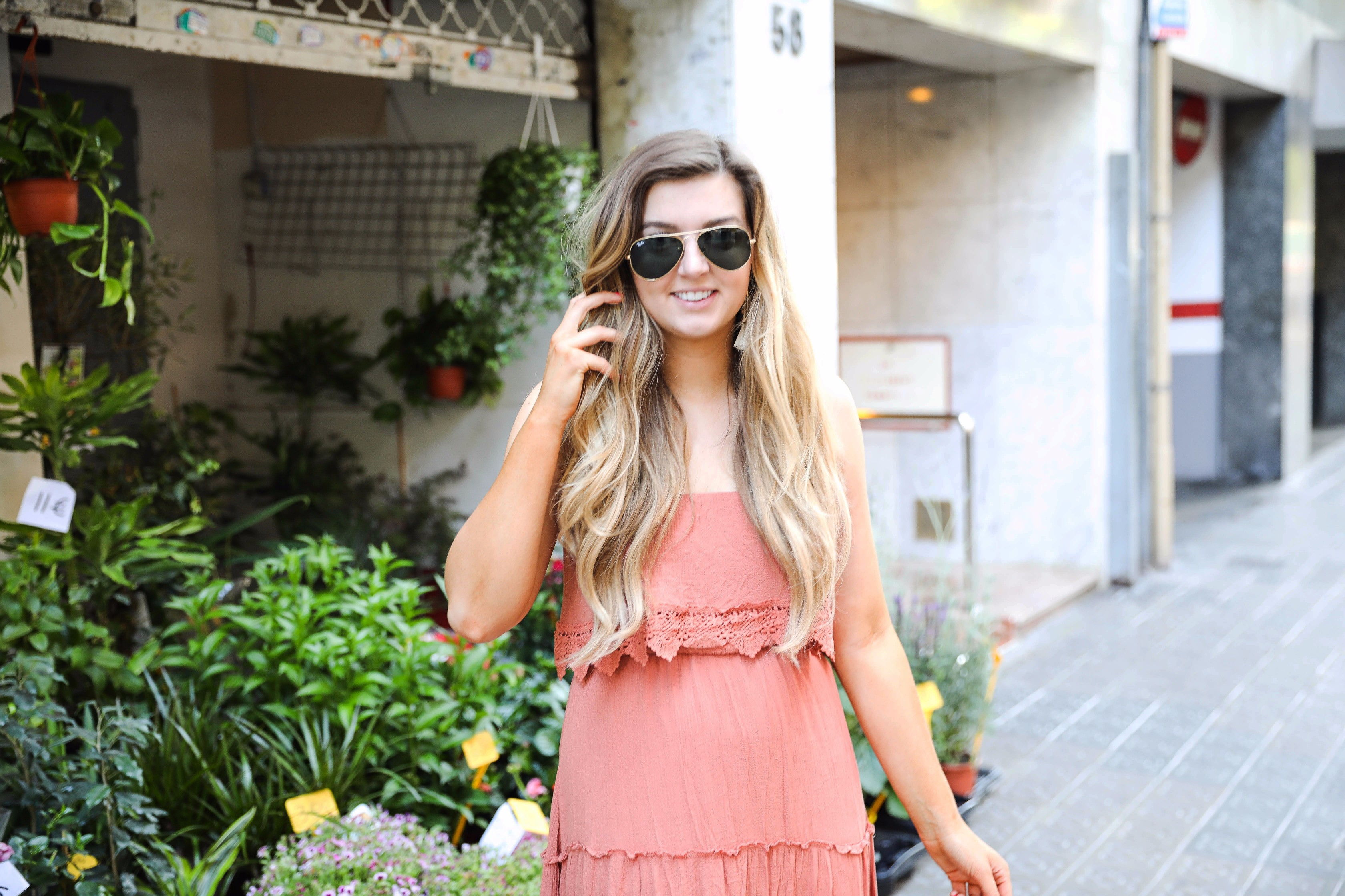 Coral maxi dress in barcelona spain fresh flower market by fashion blogger lauren lindmark daily dose of charm dailydoseofcharm.com