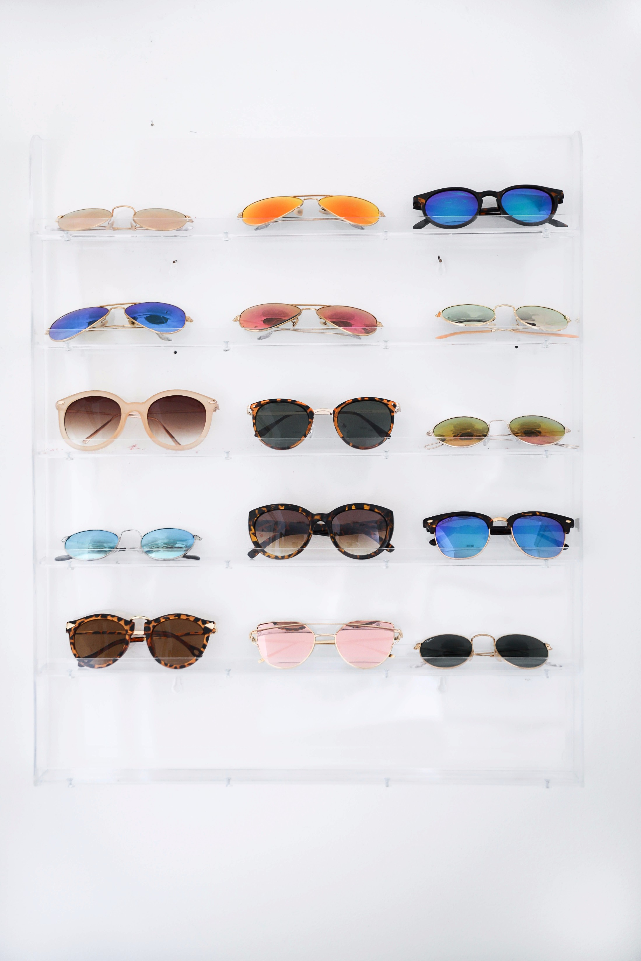Sunglasses rack June favorites by fashion and lifestyle blogger lauren lindmark on daily dose of charm