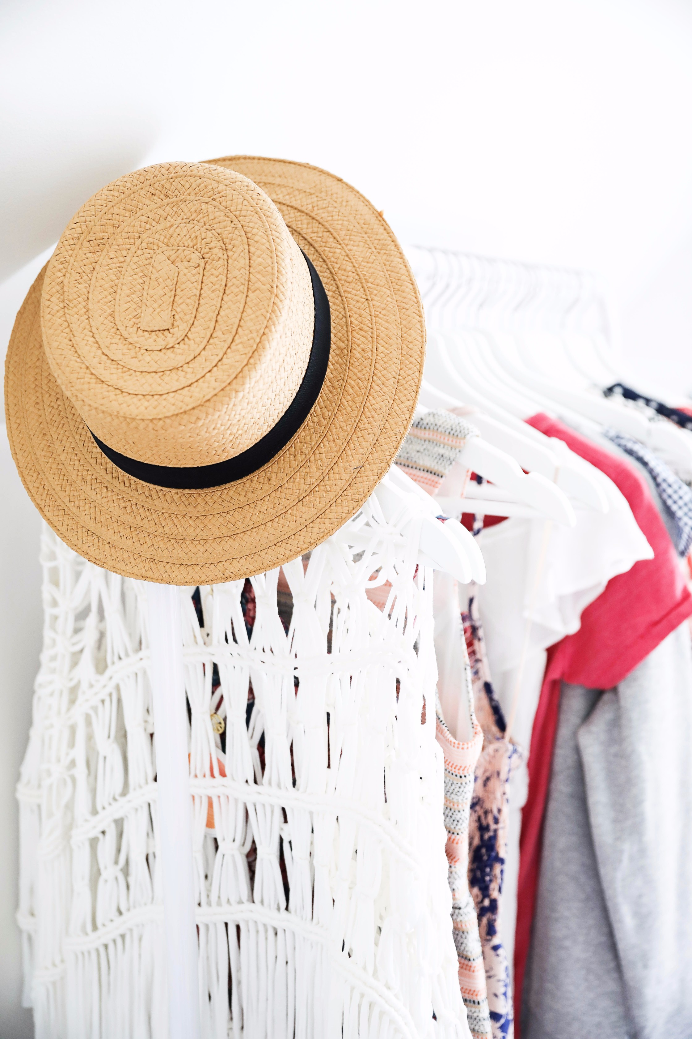 Hat and clothing rack June favorites by fashion and lifestyle blogger lauren lindmark on daily dose of charm