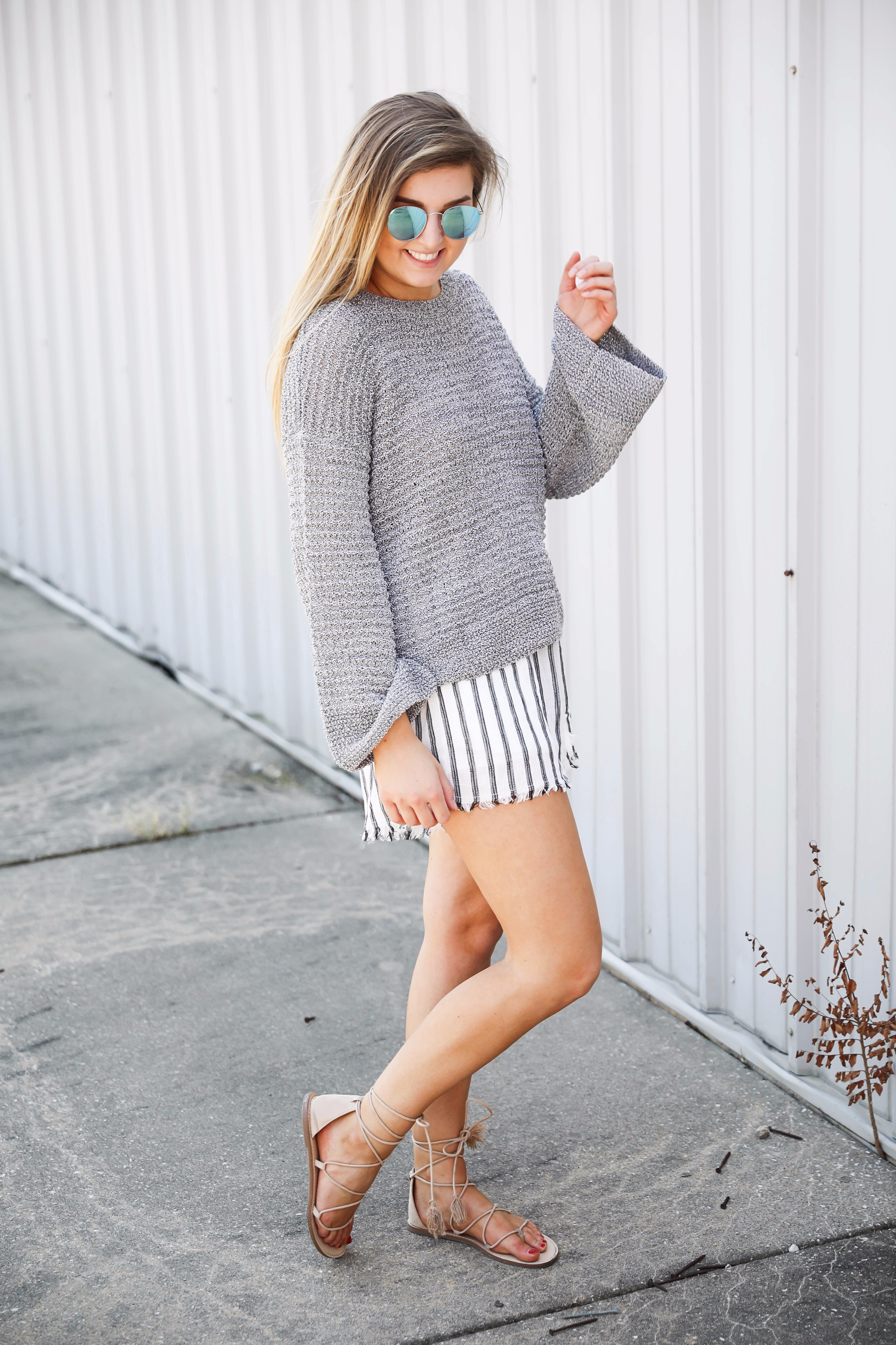 Open back sweater with striped nautical shorts by lauren lindmark on fashion blog daily dose of charm