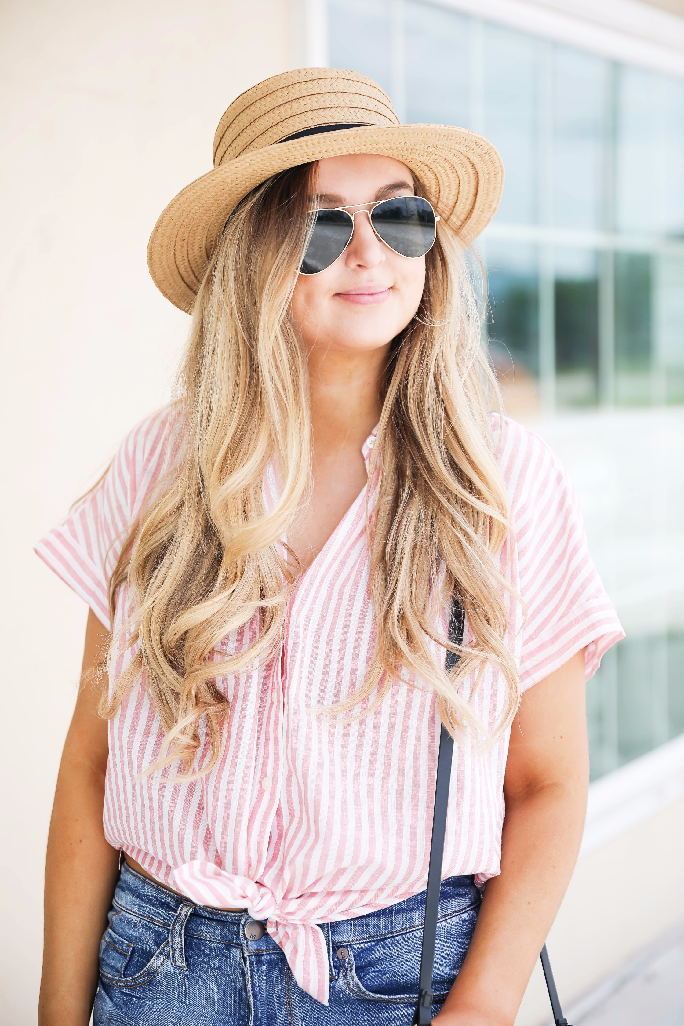 Striped red button up fourth of july outfit with Straw Boater hat by fashion blog daily dose of charm lauren lindmark
