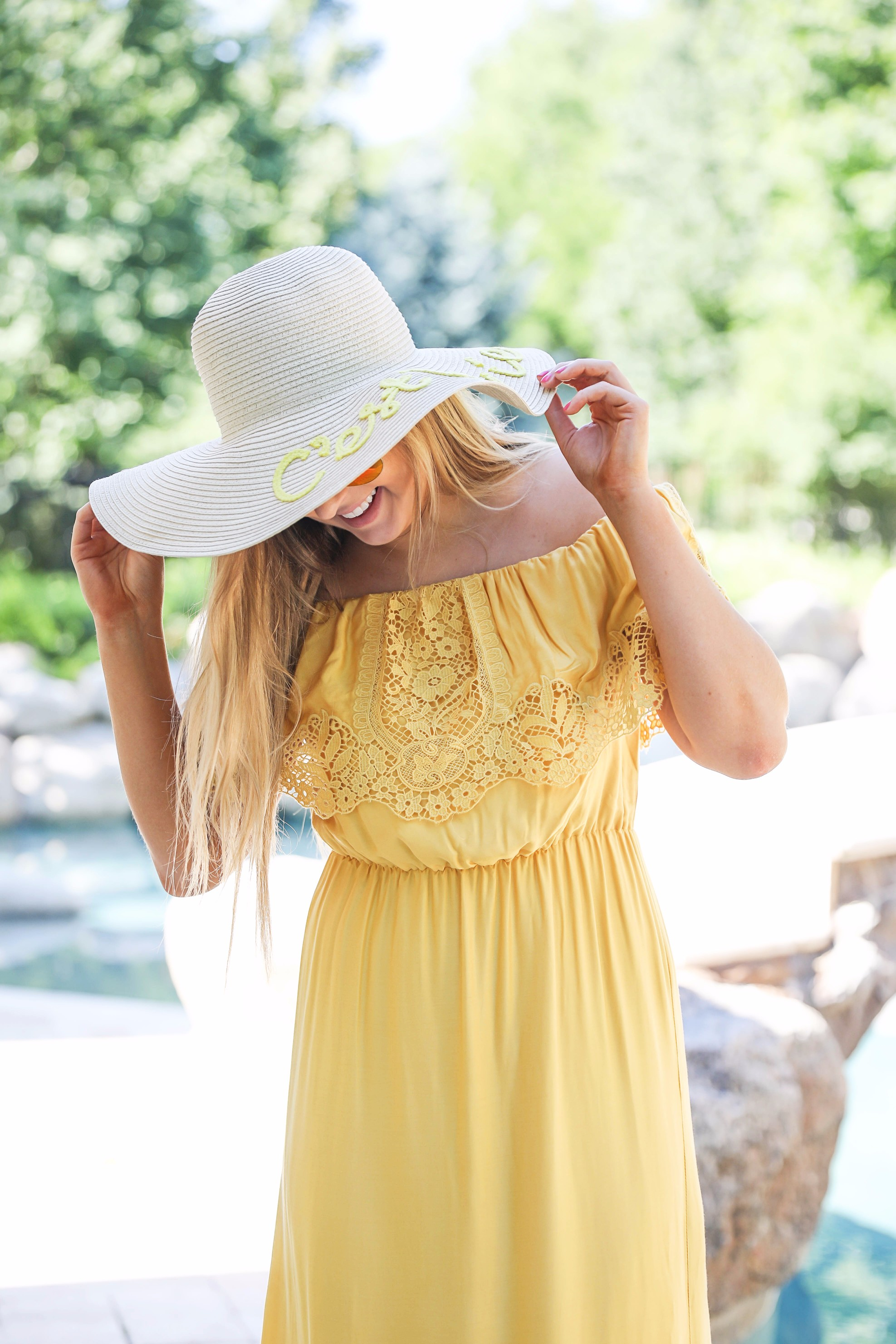 Yellow midi maxi dress poolside with cest la vie quote sun hat on fashion blog daily dose of charm by lauren lindmark
