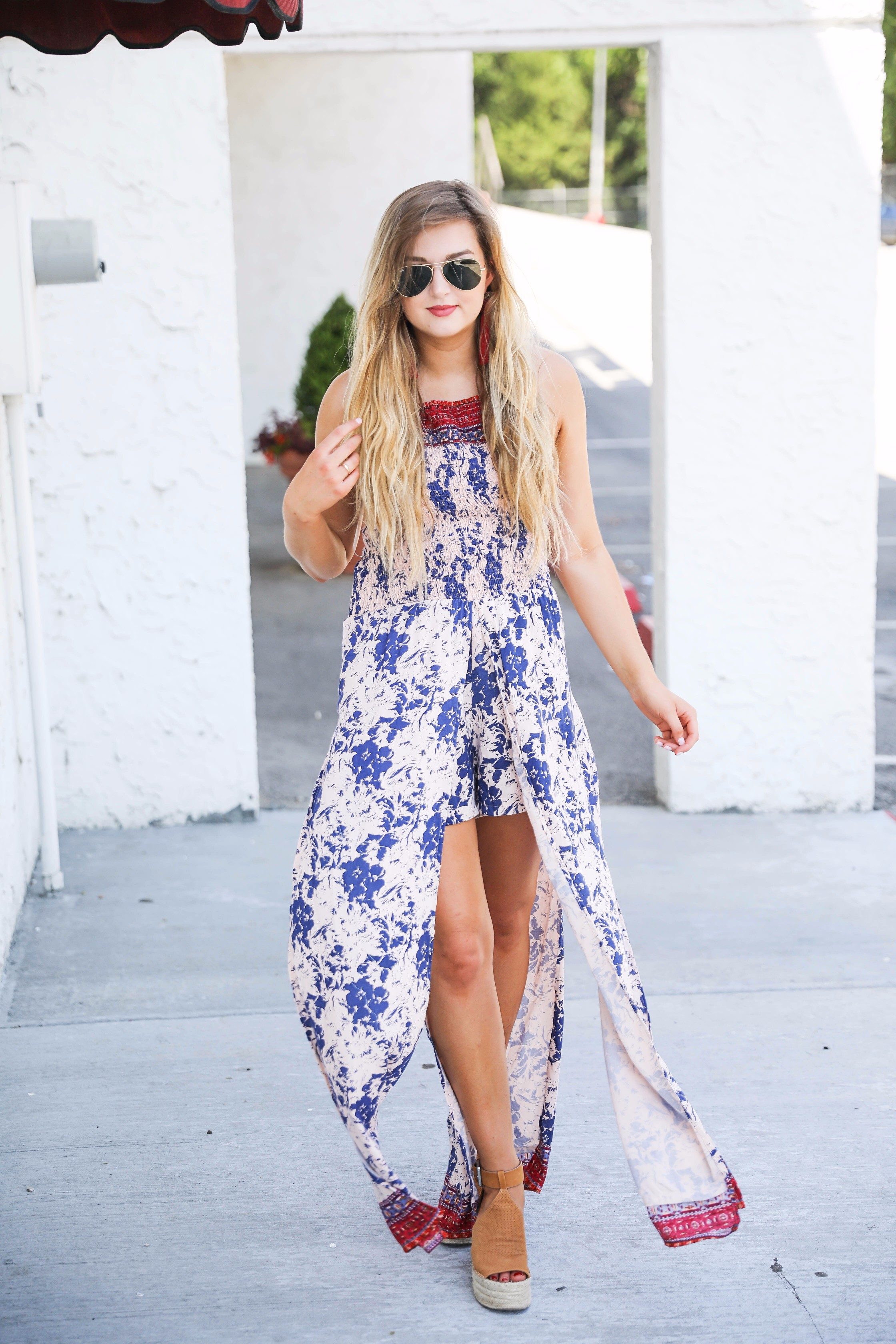 Boho halter romper maxi combo with beachy hair and a bold lip! I also paired these fun burgundy tassel earrings with the look. By fashion blogger lauren lindmakr on daily dose of charm