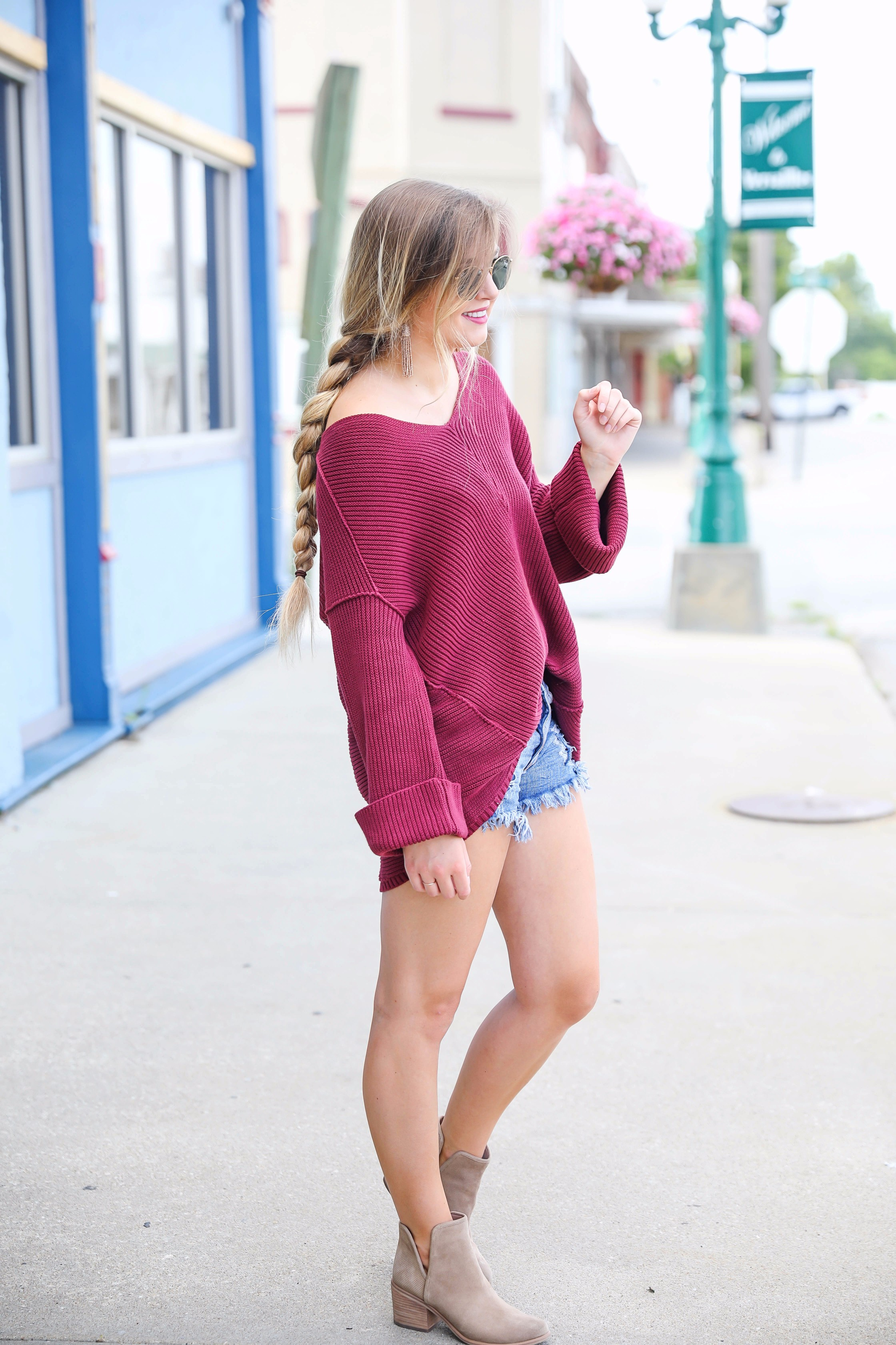 Cutest slouchy burgundy sweater worn with ripped denim shorts. This sweater is from the 2017 nordstrom anniversary sale! By fashion blogger lauren lindmark on daily dose of charm dailydoseofcharm.com