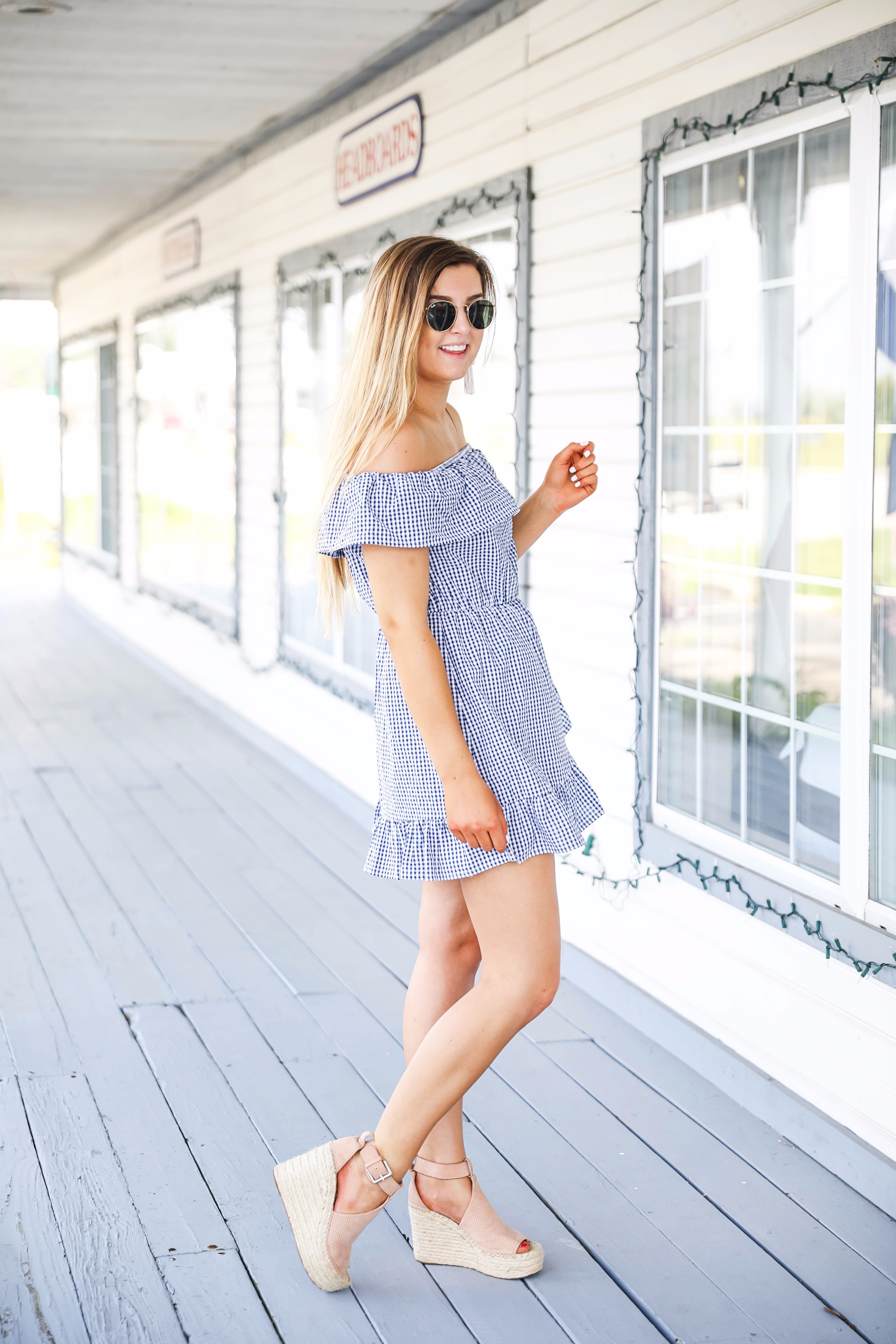 Gingham ruffle dress and round rayb ban sunglasses with tassel earrings on fashion blog daily dose of charm by lauren lindmark