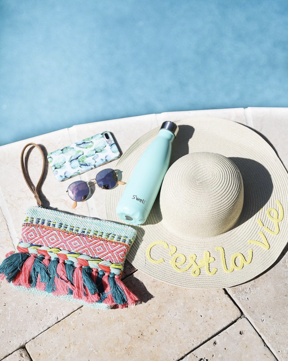 Colorful tassel clutch, S'Well bottle, cactus phone case, sunglasses, and c'est la vie sun hat on June Instagram Roundup 2017 on fashion Instagram @dailydoseofcharm by fashion blogger daily dose of charm AKA lauren lindmark