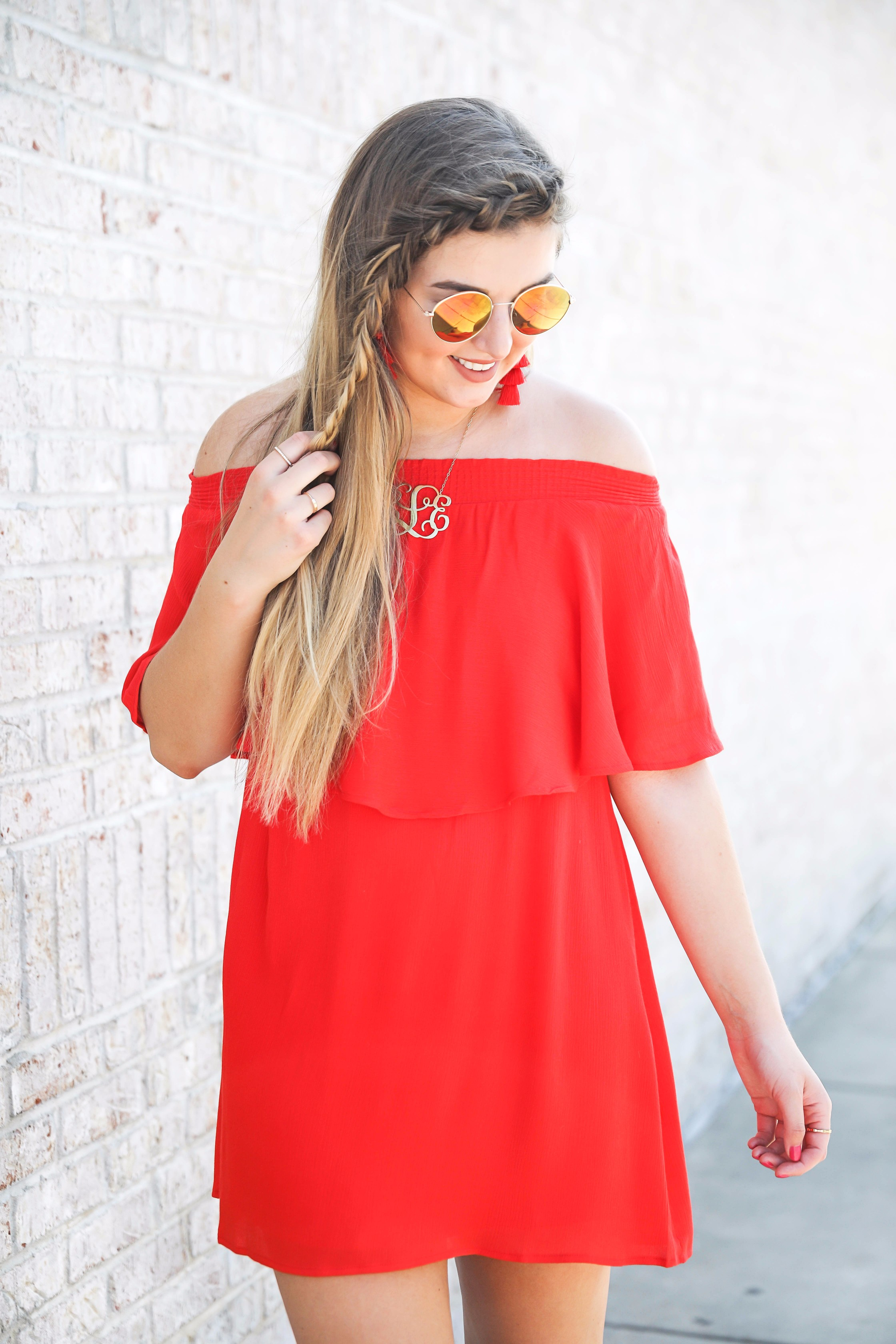 Red off the shoulder dress y Show Me Your MuMu! The cutest dress for summer paired with red tassel earrings, red circle sunglasses, and wedges. Braided fish tail hair. By fashion blogger lauren lindmark daily dose of charm