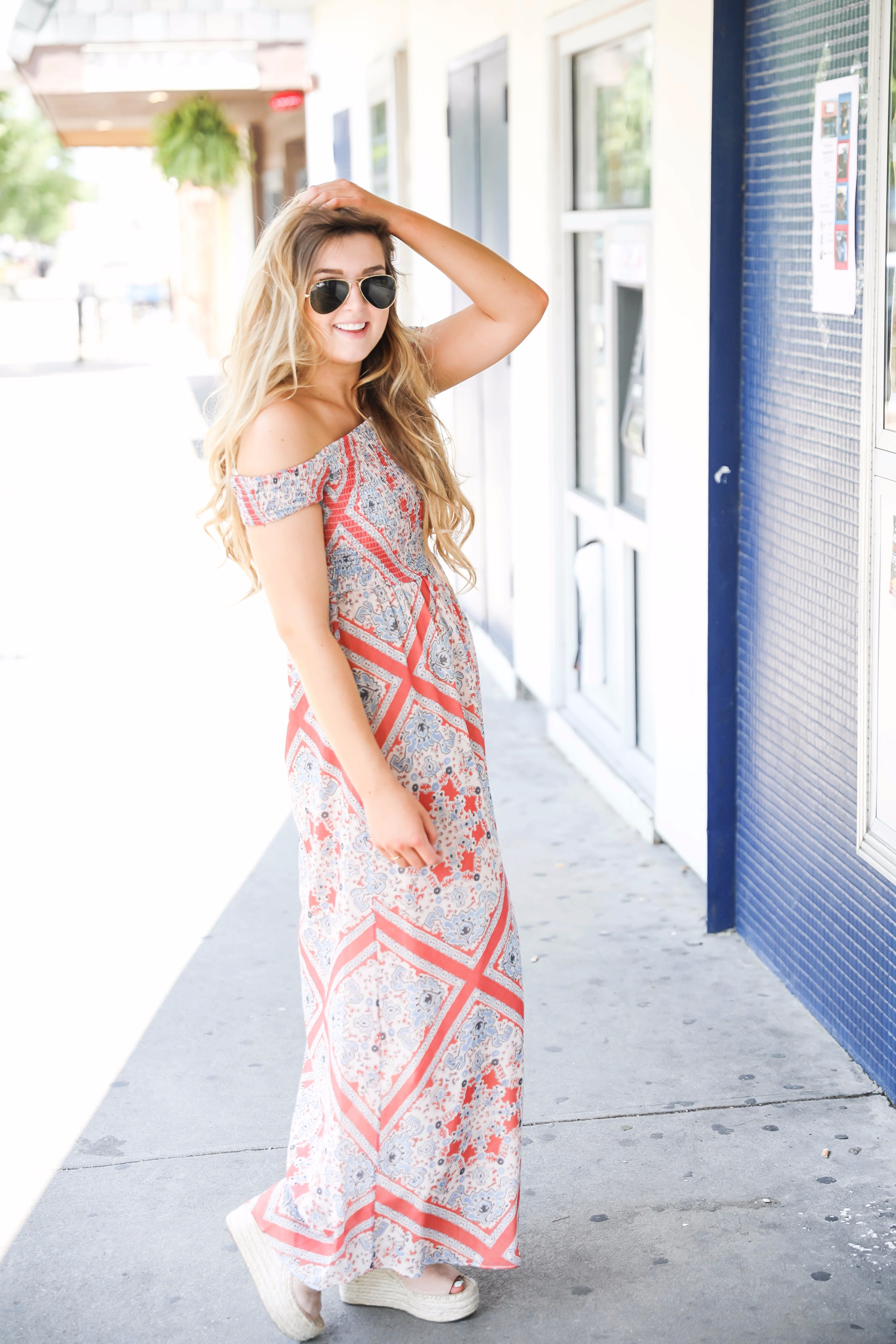 The cutest flowy off the shoulder dress. I love the dun pattern and the coral, orange and blue is so unique! Maxi dresses are my favorite. on fashion blog daily dose of charm by lauren lindmark