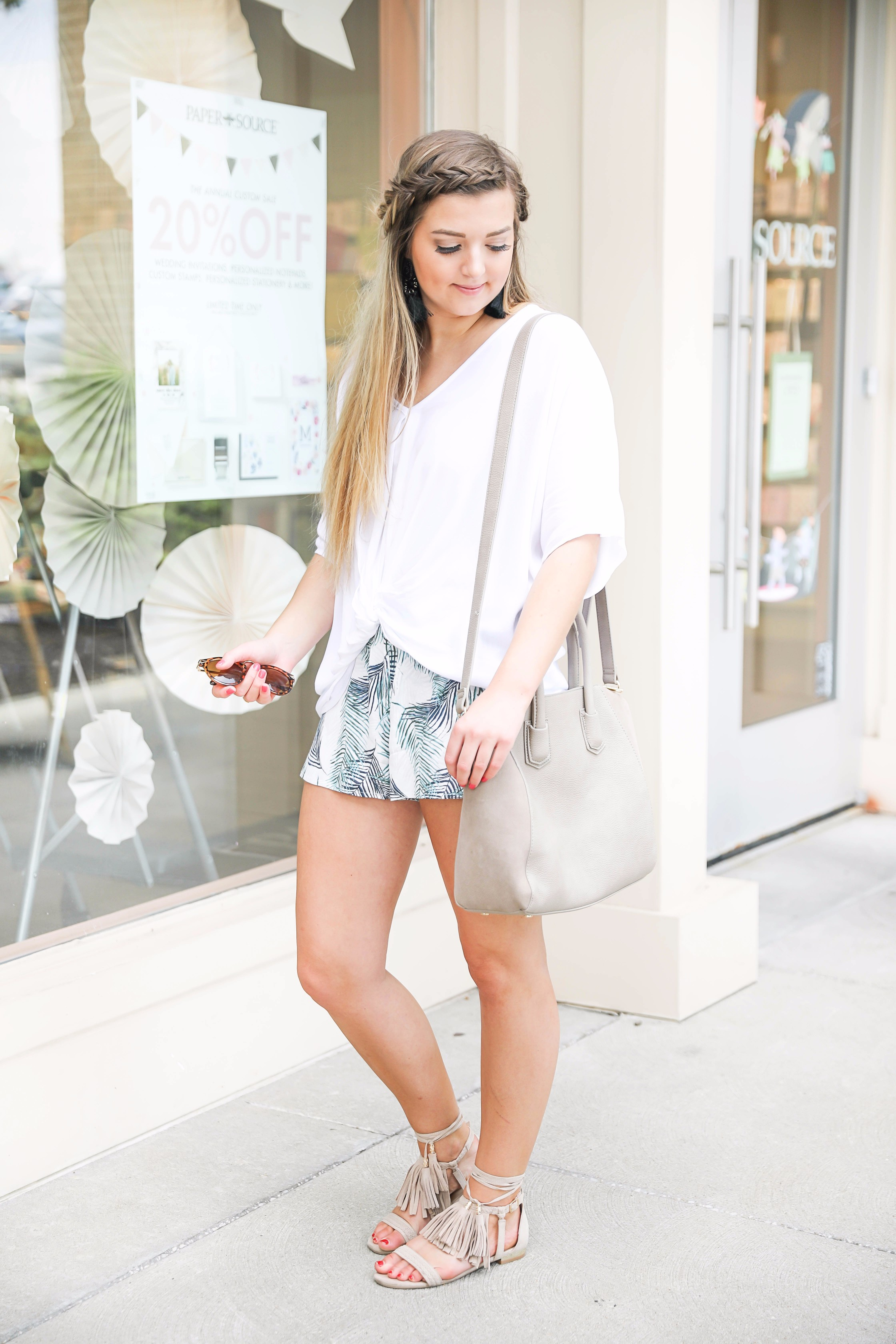 Tropical palm leaf shorts with a white tied tee! Such a cute, simple outfit. I did my hair in a crown fishtail braid and paired the look with my favorite black tassel earrings that are $13 and a fun bag from the Nordstrom Sale! Details on fashion blogger daily dose of charm by lauren lindmark