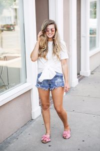 White tied bow tee makes a classic white shirt look so much cuter! I paired it with my favorite pink same edelman bow sandal and bauble bar earrings. by fashion blogger lauren lindmark on daily dose of charm
