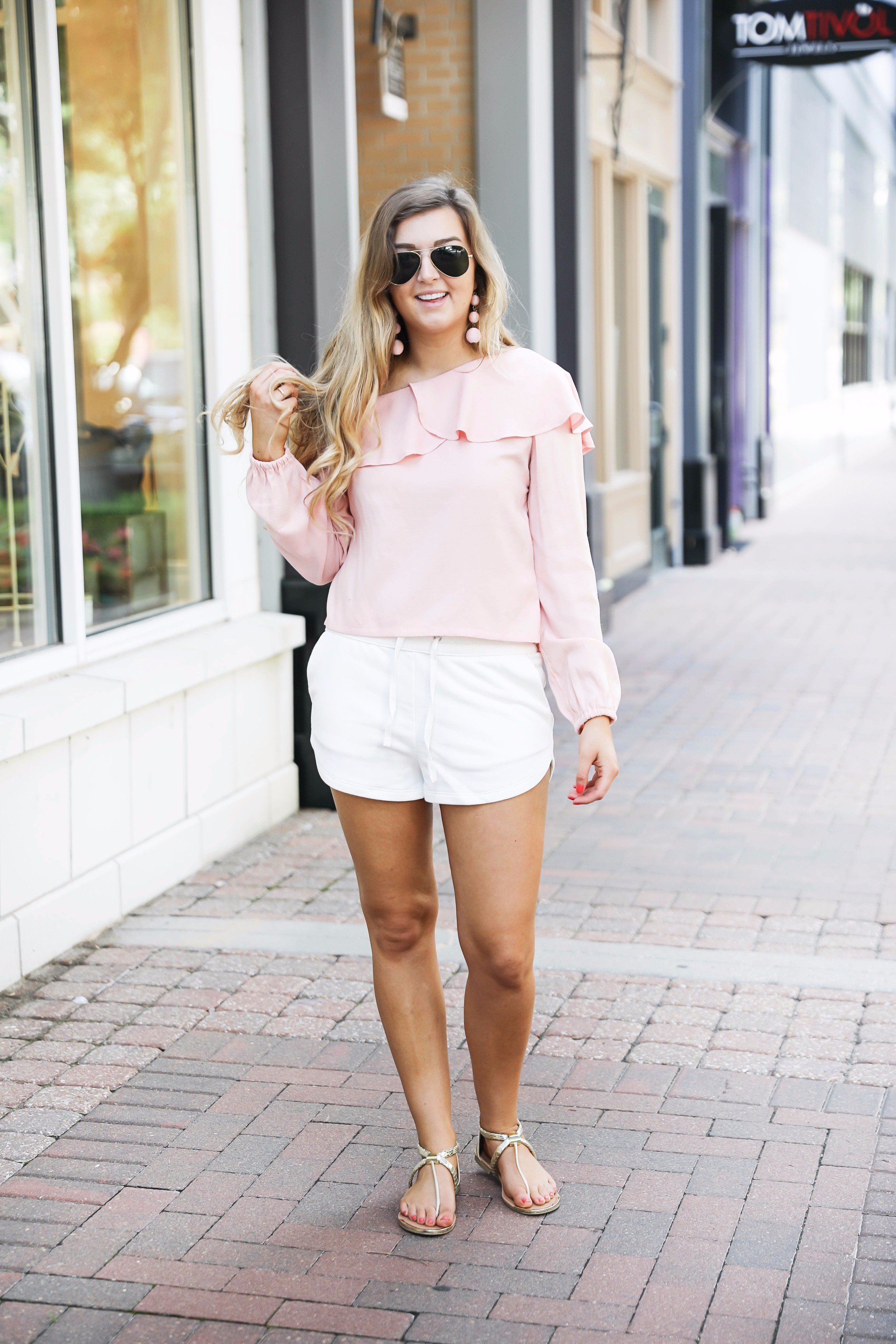 Casual outfit! I love this pink ruffle top with my favorite white sweatshorts that are only $13! On fashion blog daily dose of charm by lauren lindmark