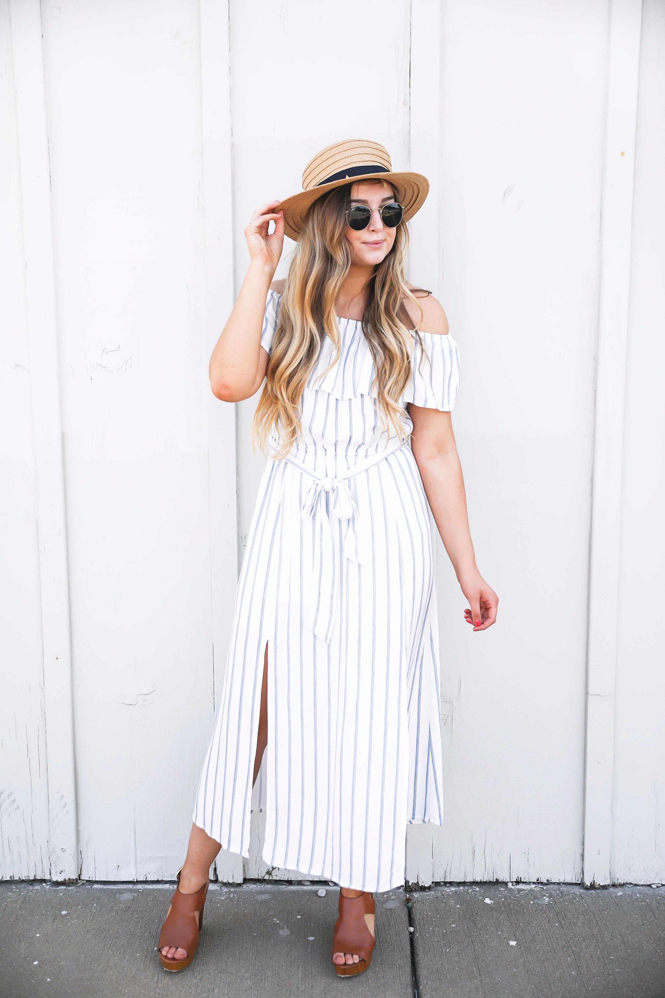 Navy and white striped off the shoulder boardwalk dress! I paired it with a cute boat hat and clubmasters! By fashion blogger daily dose of charm lauren lindmark