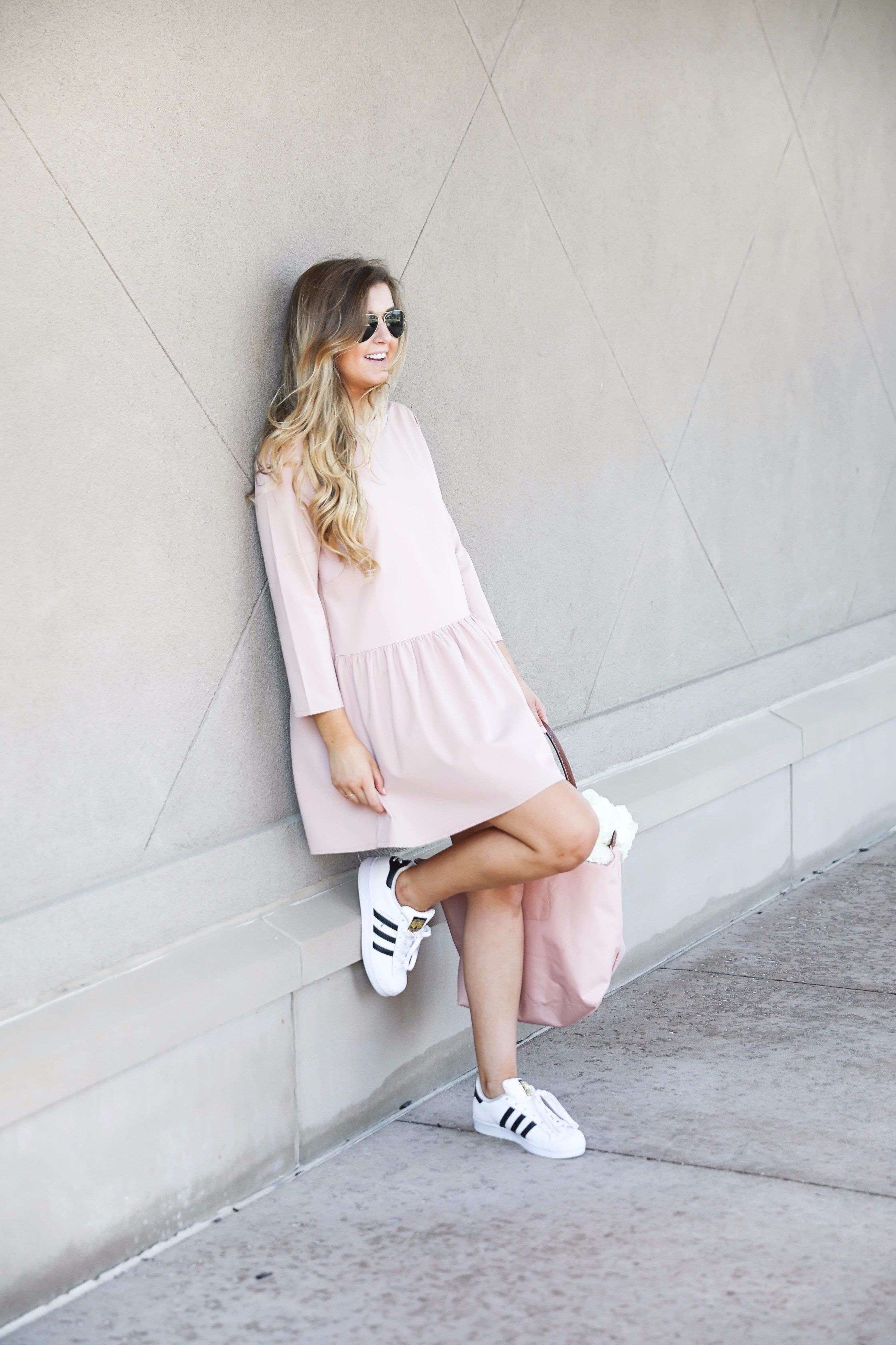 Pink drop waist dress with Adidas sneakers! Such a cute and casual look. I paired it with my favorite light pink longchamp with hydrangeas! By fashion blog daily dose of charm lauren lindmark