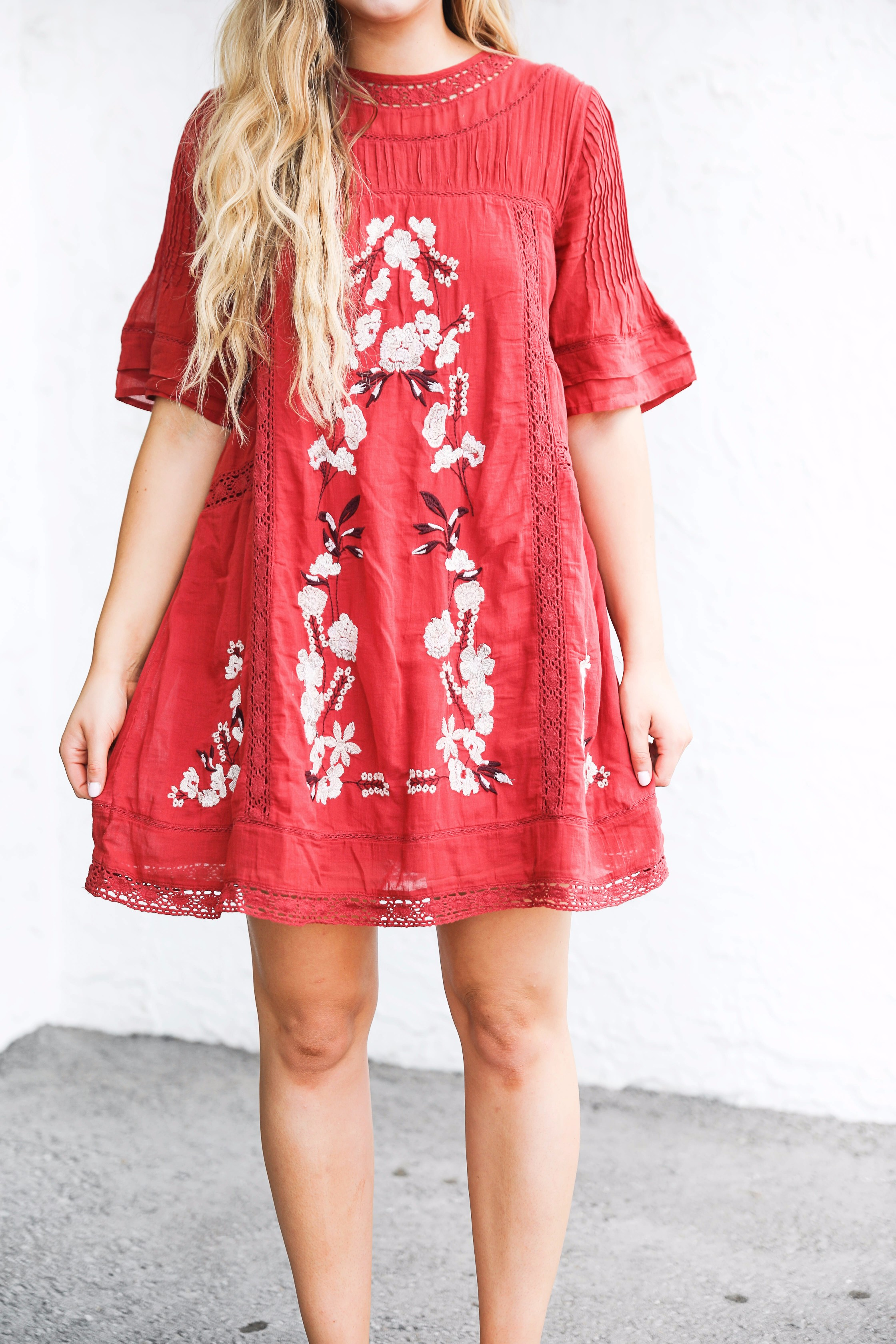 Red free people fall dress! I love this bright red color for fall. There are so many ways to wear this! It would be super cute with boots or booties! by fashion blogger lauren lindmark on daily dose of charm