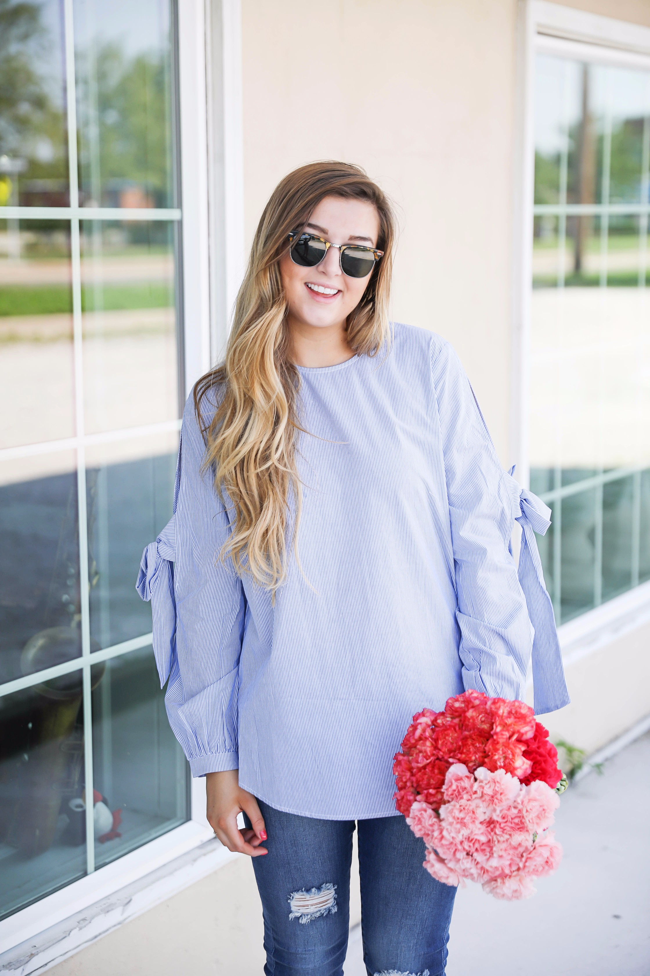Seersucker bow sleeve cold shoulder top and tape in extensions! The prettiest flowers with the cutest outfit! on fashion blog daily dose of charm by lauren lindmark
