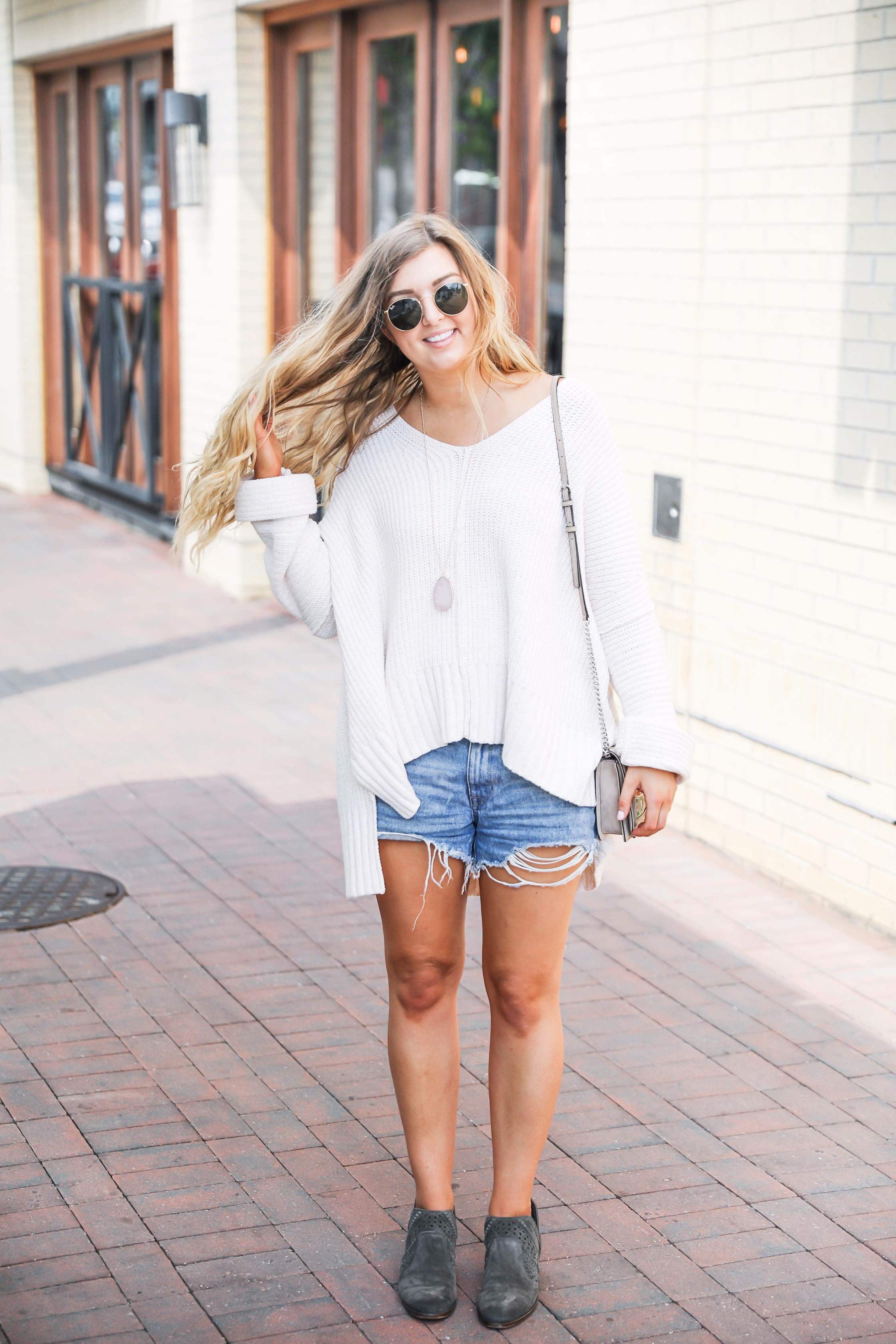 The cutest and comfiest white oversized free people sweater on fashion blog daily dose of charm by lauren lindmark