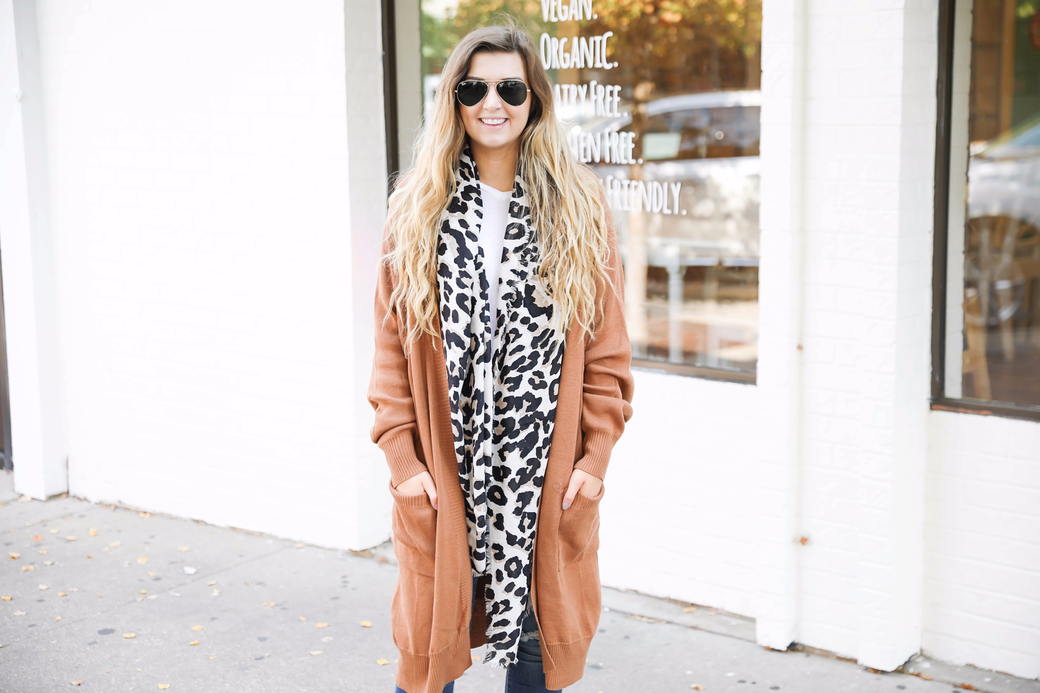 Adorable leopard scarf paired with a burnt orange cardigan! This is the fall outfit you need in your closet! Leopard is so in right now and this scarf is a necessity! The burnt orange cardigan in a staple! Find the details on fashion blog daily dose of charm by lauren lindmark
