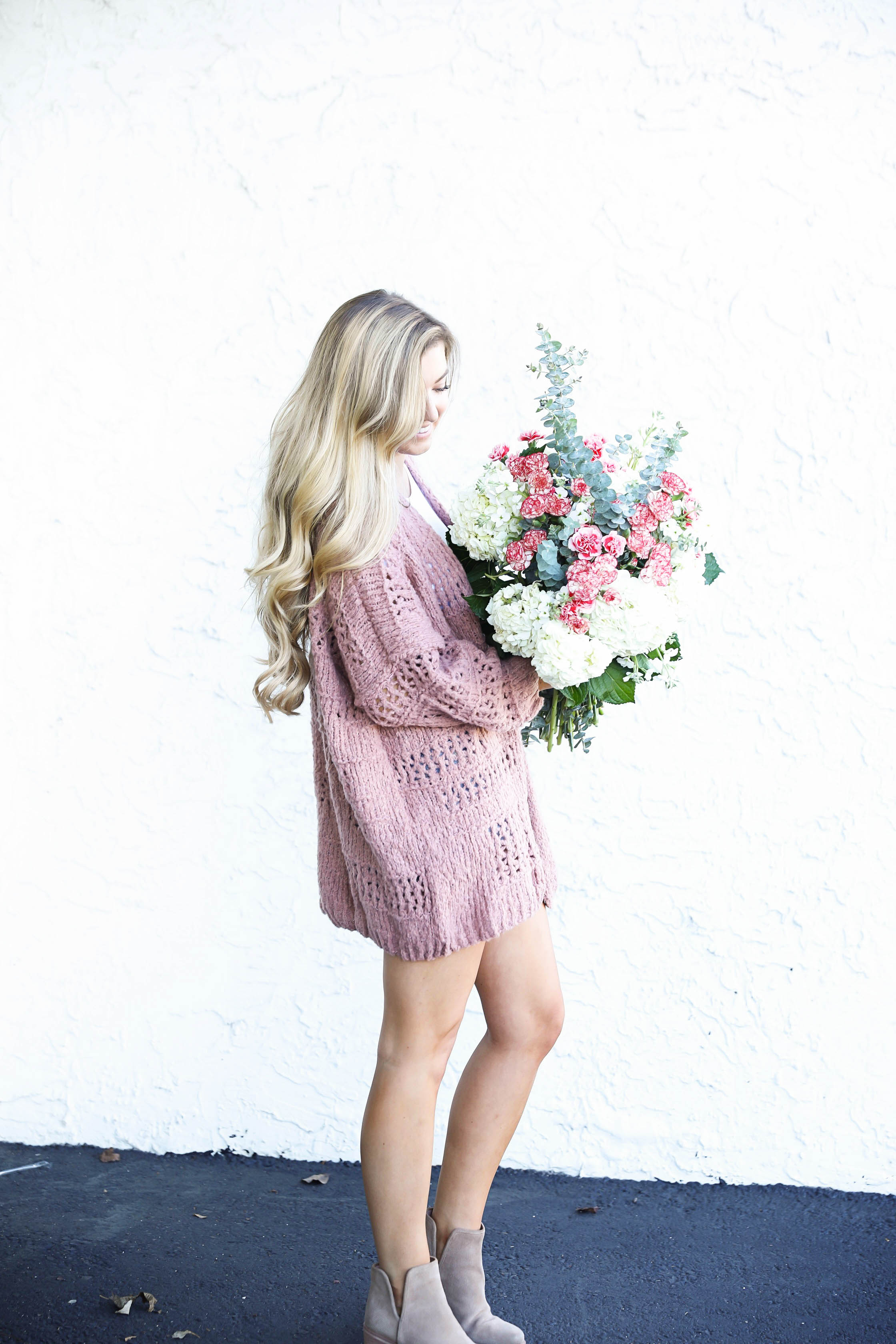 Free people cardigan and fresh flowers with long curly hair by fashion blog daily dose of charm lauren lindmark