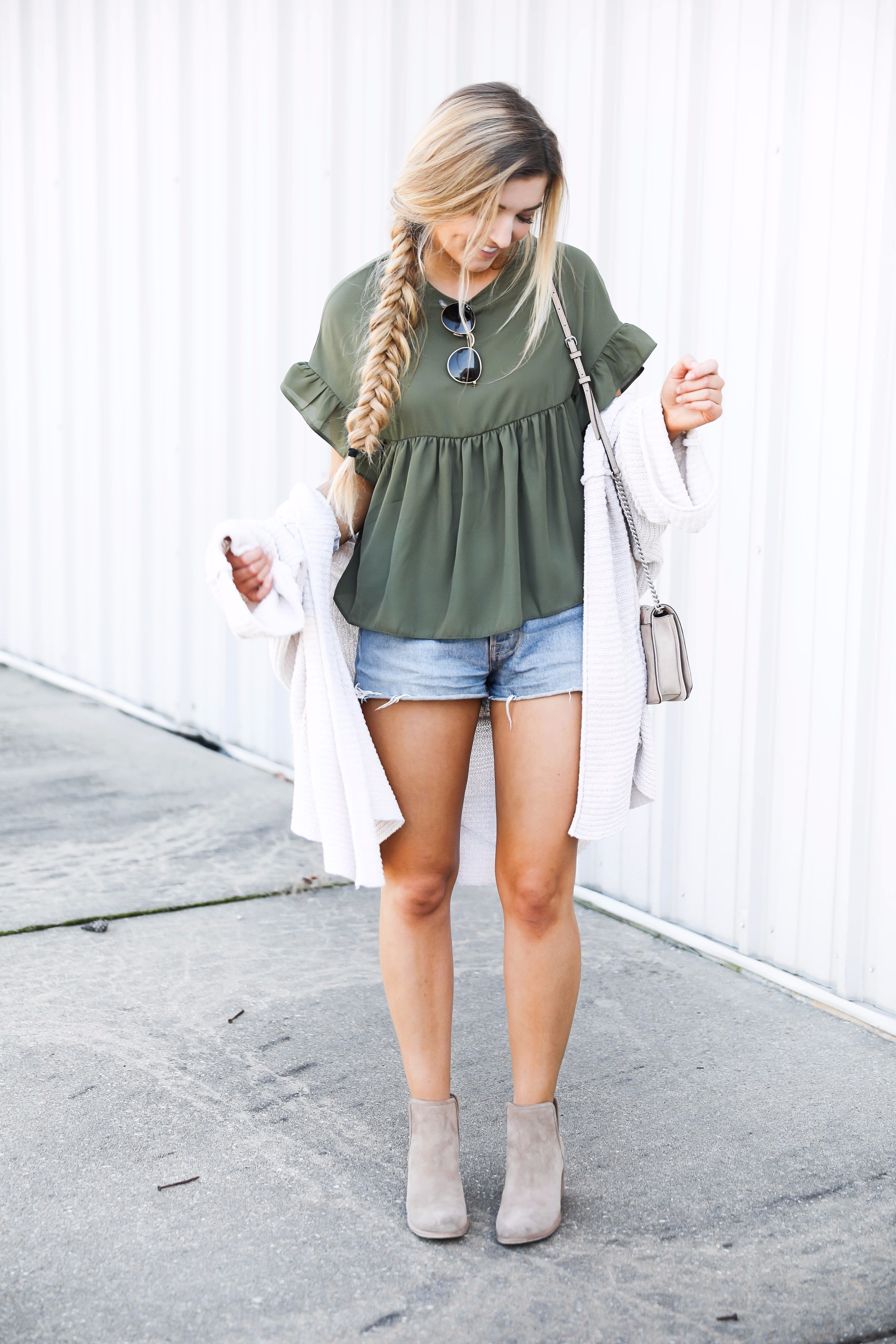 Olive ruffle top with a free people slouchy cardigan! I love olive for fall. This look is autumn perfection with the booties! Find the details on fashion blog daily dose of charm by lauren lindmark