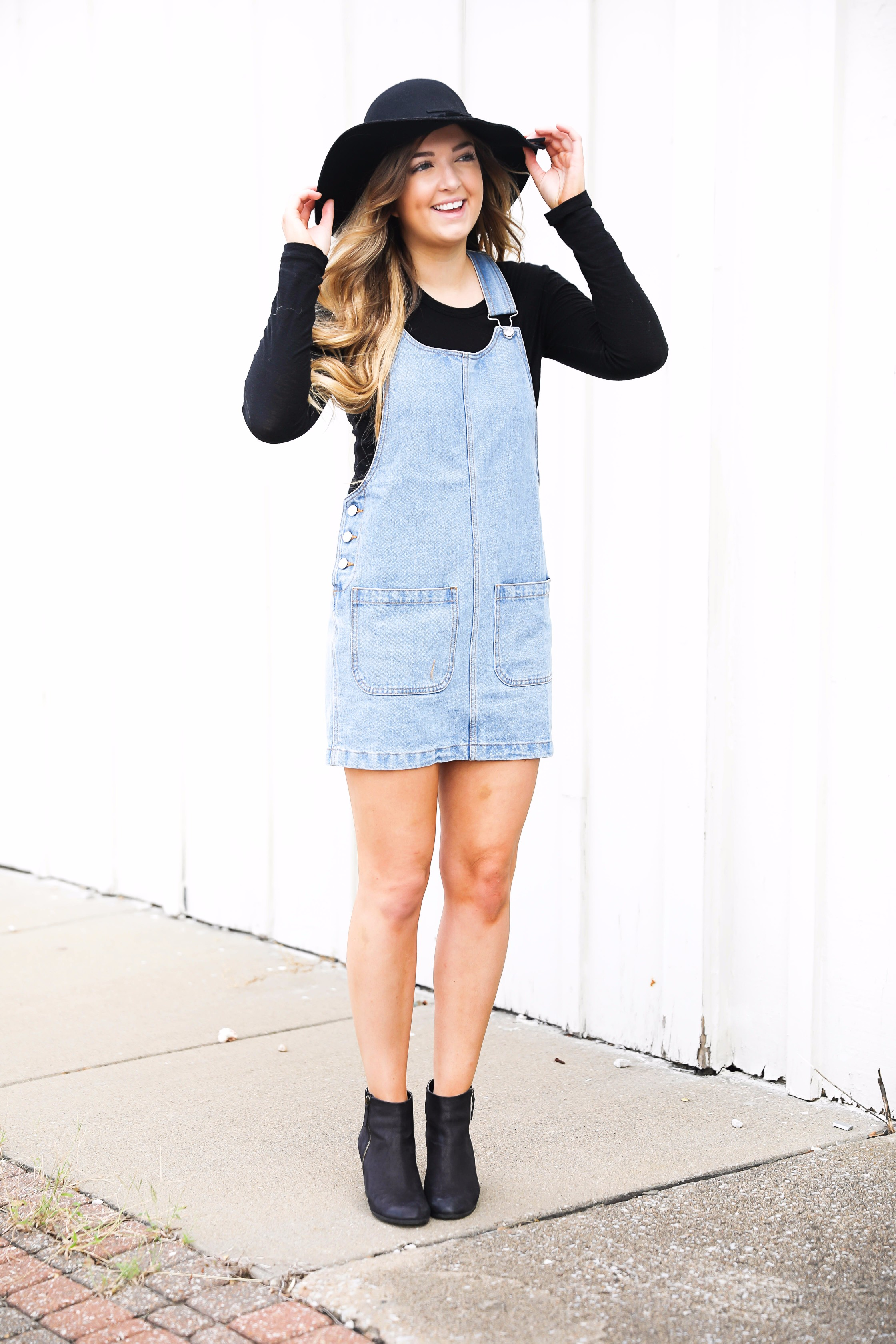 Overall dress and black floppy hat and black booties! I love ...